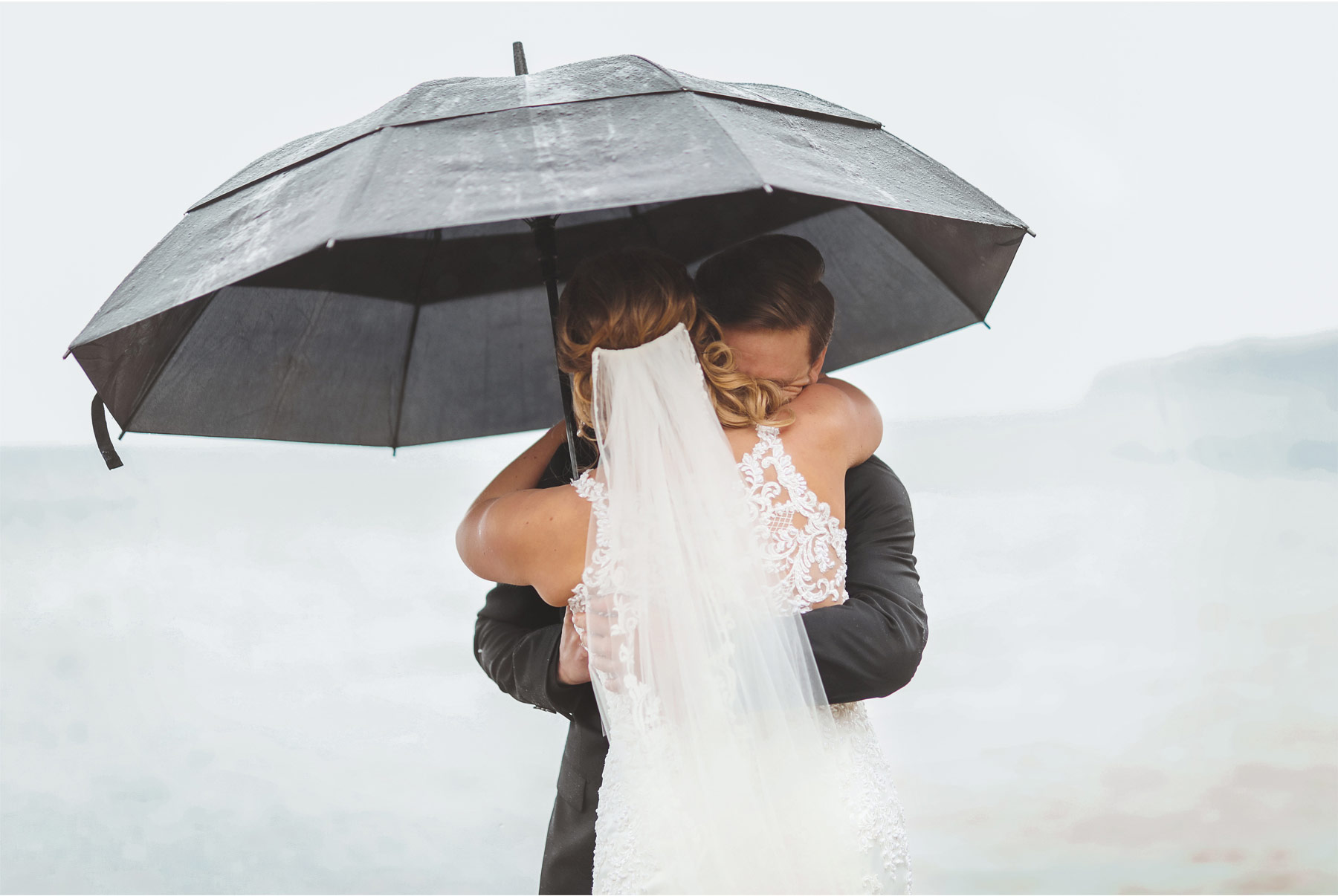 07-Minnesota-Wedding-by-Andrew-Vick-Photography-Grand-Superior-Lodge-Duluth-Two-Harbors-Bride-Dress-Lake-Superior-Rain-Umbrella-Groom-Veronica-and-Tyler.jpg