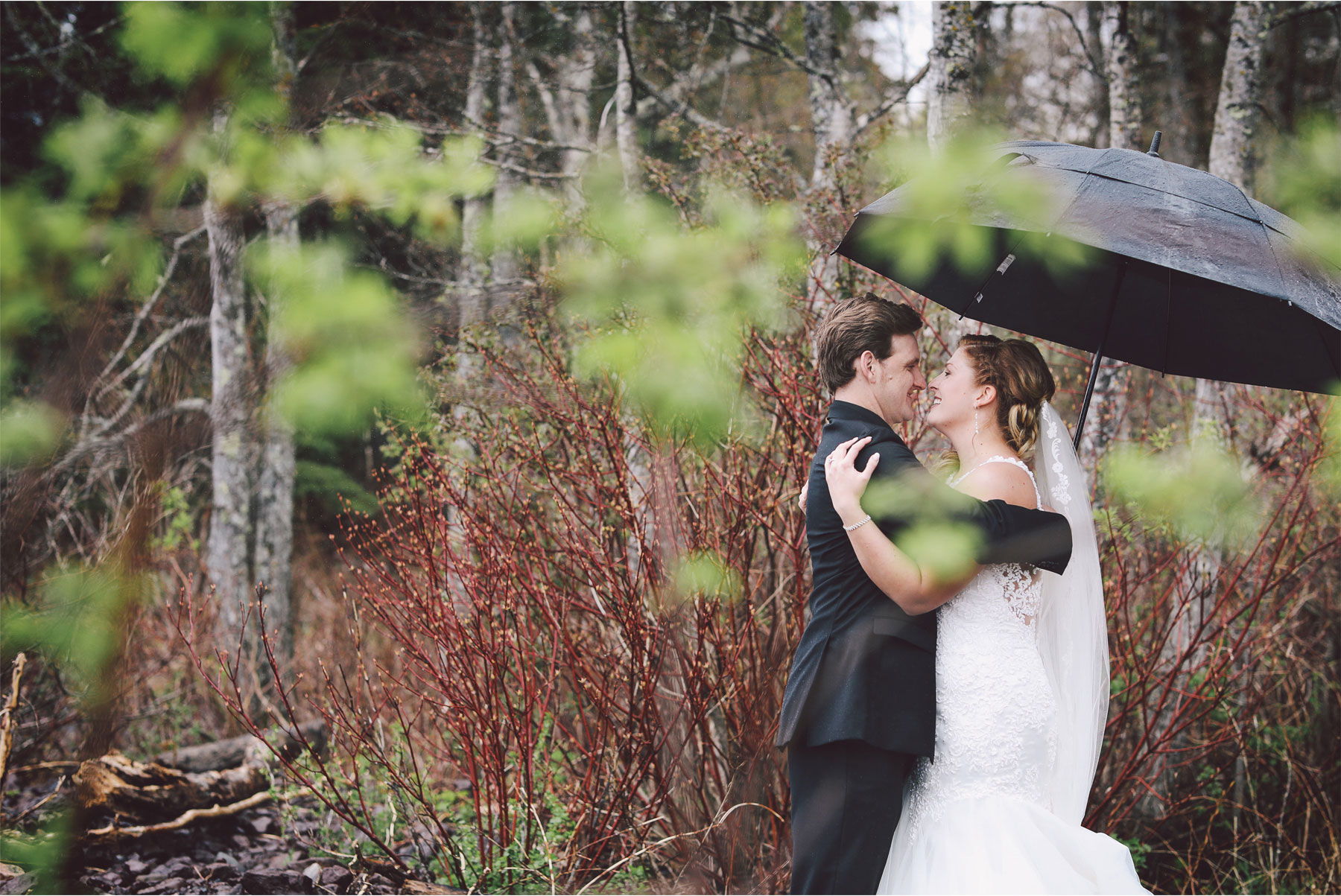 10-Minnesota-Wedding-by-Andrew-Vick-Photography-Grand-Superior-Lodge-Duluth-Two-Harbors-Bride-Dress-Lake-Superior-Rain-Umbrella-Woods-Groom-Veronica-and-Tyler.jpg