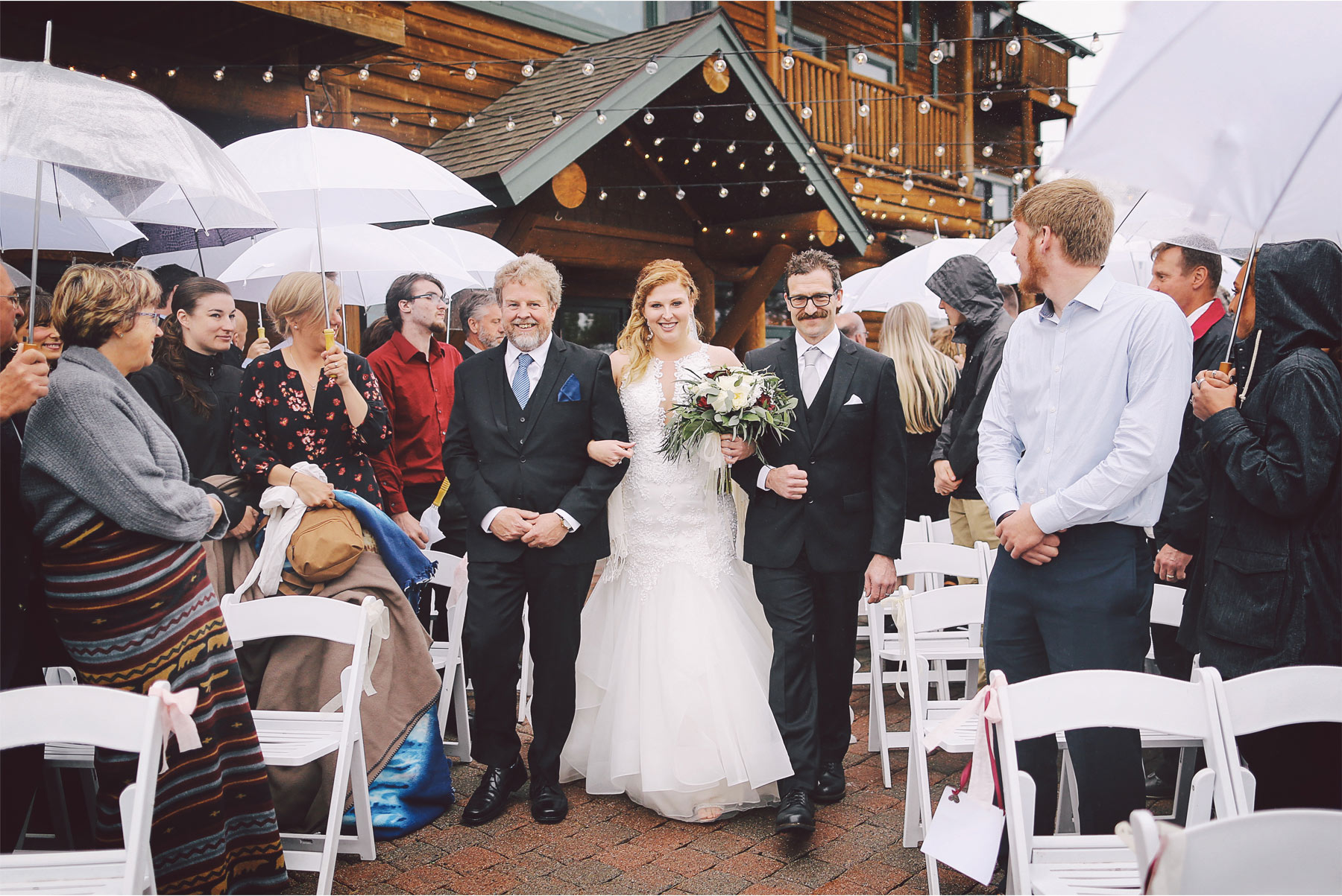 14-Minnesota-Wedding-by-Andrew-Vick-Photography-Grand-Superior-Lodge-Duluth-Two-Harbors-Outdoor-Ceremony-Rain-Umbrellas-Aisle-Bride-Fathers-Veronica-and-Tyler.jpg