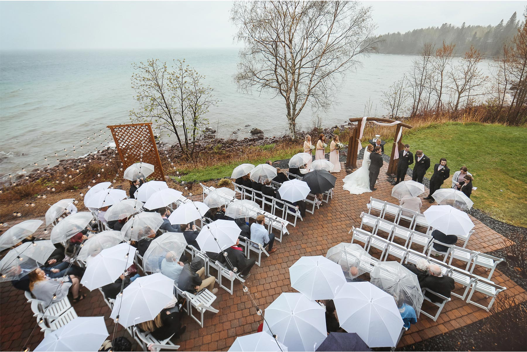 15-Minnesota-Wedding-by-Andrew-Vick-Photography-Grand-Superior-Lodge-Duluth-Two-Harbors-Outdoor-Ceremony-Lake-Superior-Rain-Umbrellas-Veronica-and-Tyler.jpg