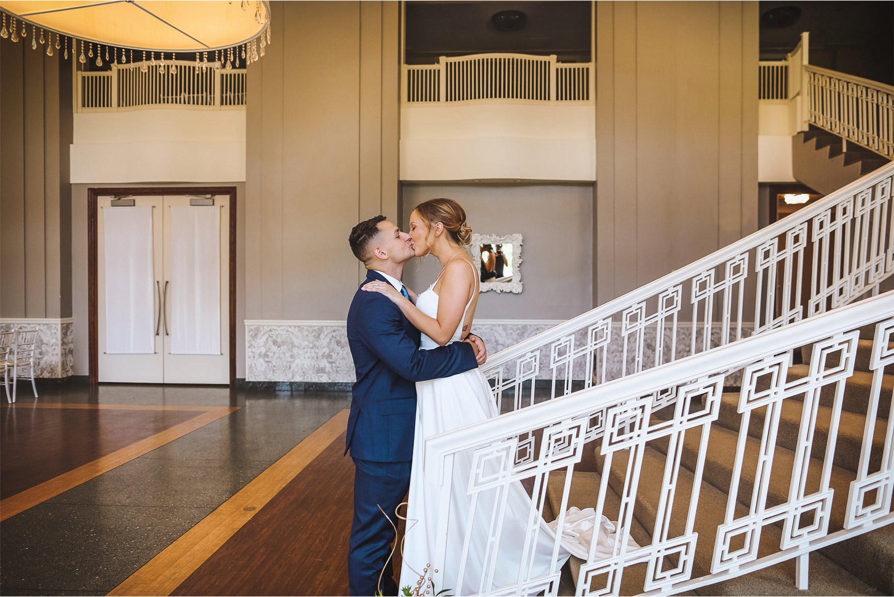 04-Minneapolis-Minnesota-Wedding-Andrew-Vick-Photography-Calhoun-Beach-Club-Bride-Groom-First-Look-Staircase-Samantha-and-Ryan.jpg