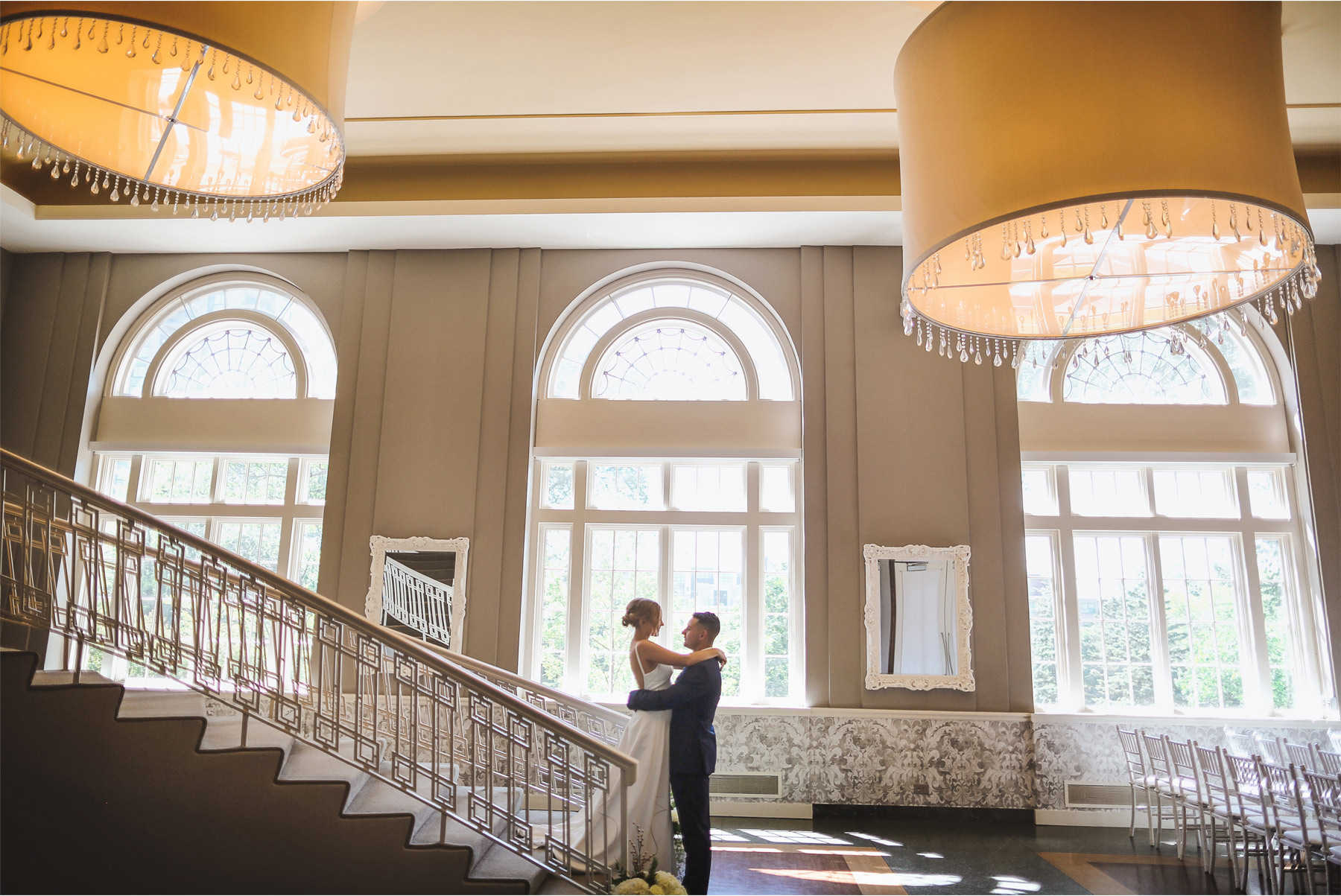 05-Minneapolis-Minnesota-Wedding-Andrew-Vick-Photography-Calhoun-Beach-Club-Bride-Groom-First-Look-Staircase-Samantha-and-Ryan.jpg