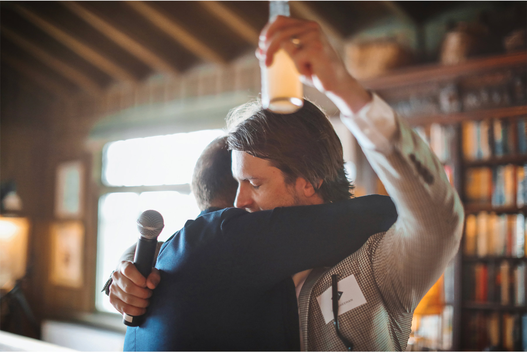 03-Vick-Photography-Wedding-Stouts-Island-Lodge-Wisconsin-Summer-Toast-Hug-MiJa-and-Lucius.jpg