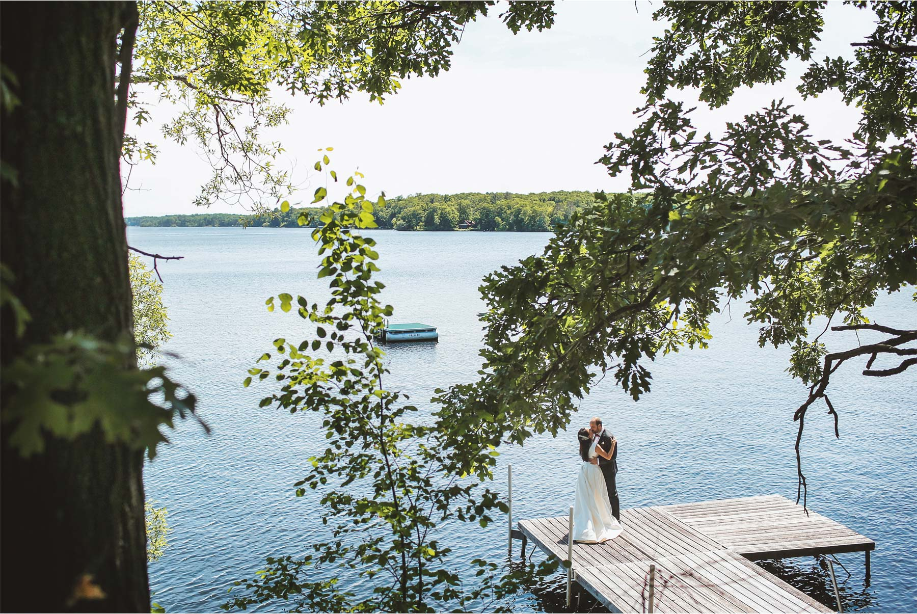09-Vick-Photography-Wedding-Stouts-Island-Lodge-Wisconsin-Summer-First-Look-Lake-Groom-Bride-Kiss-MiJa-and-Lucius.jpg
