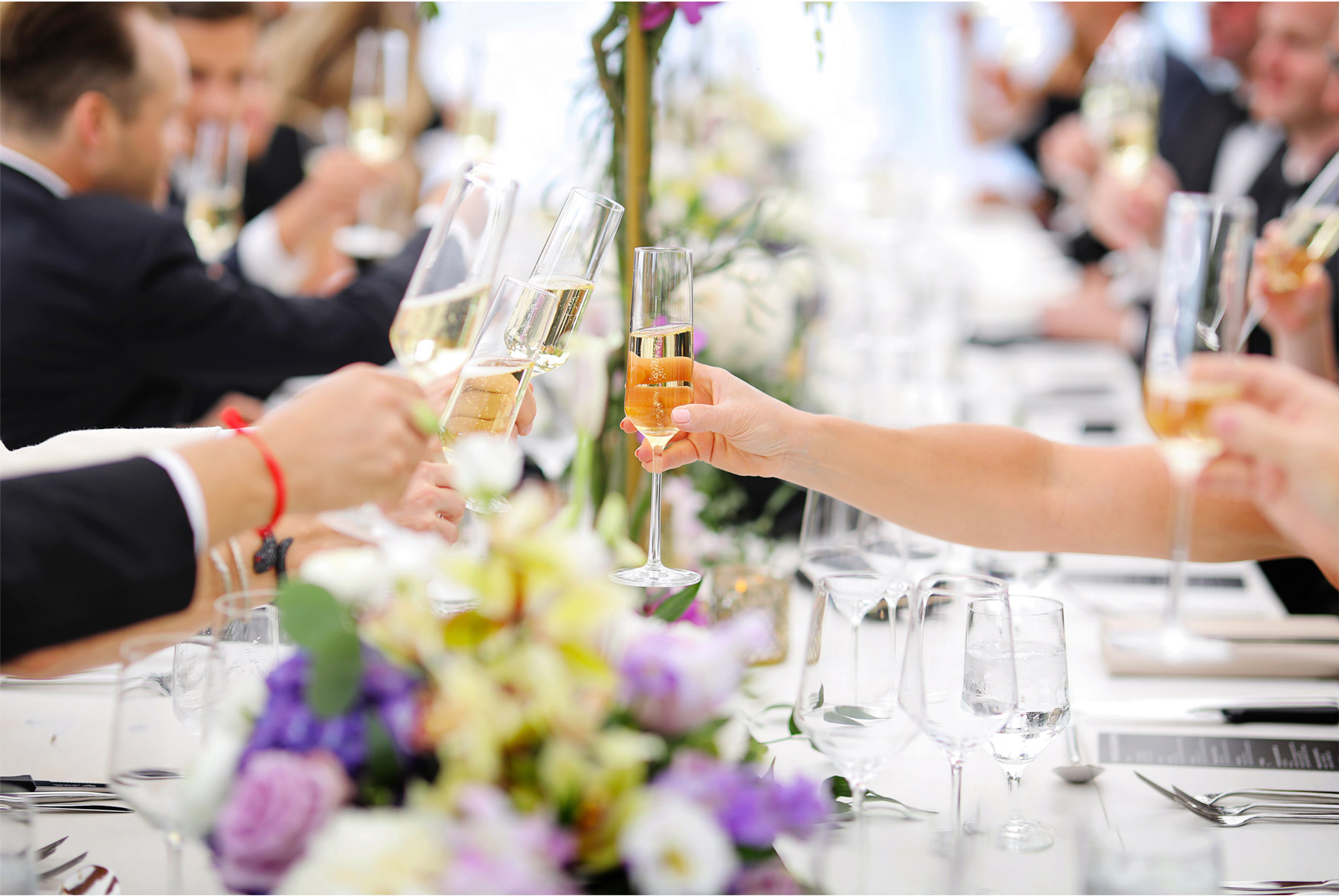 16-Vick-Photography-Wedding-Stouts-Island-Lodge-Wisconsin-Summer-Reception-Outdoor-Flowers-Toast-Cheers-MiJa-and-Lucius.jpg