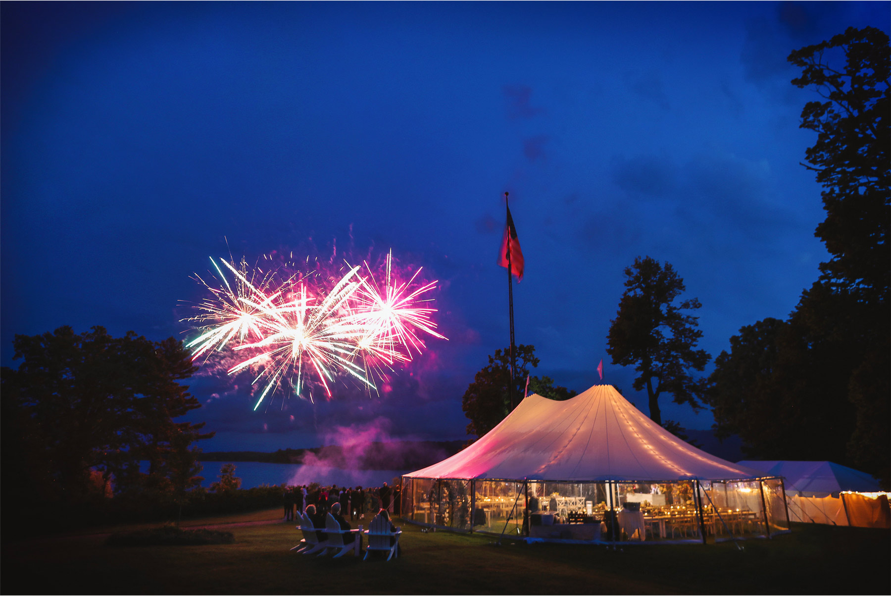 27-Vick-Photography-Wedding-Stouts-Island-Lodge-Wisconsin-Summer-Reception-Outdoor-Fireworks-Tent-MiJa-and-Lucius.jpg