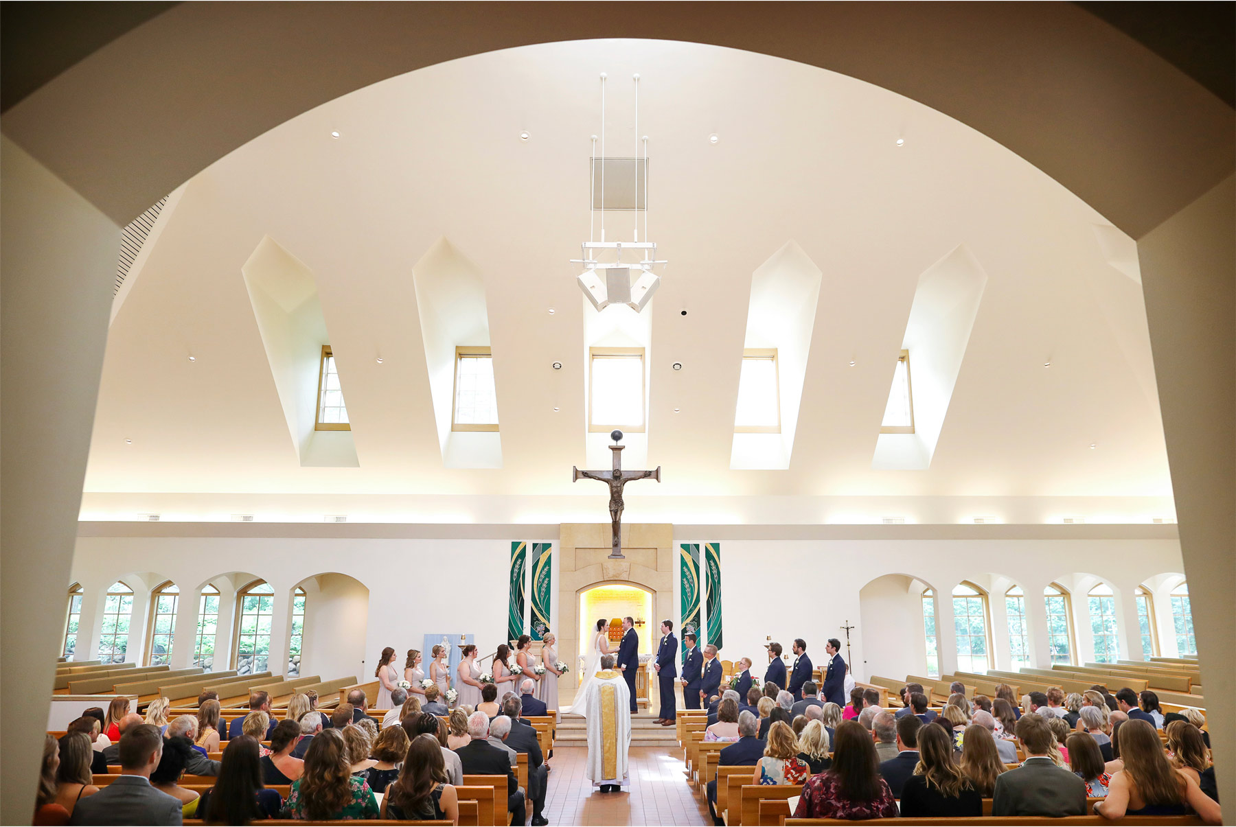 13-Vick-Photography-Wedding-Minneapolis-Minnesota-Our-Lady-of-Grace-Catholic-Church-Ceremony-Hug-Erin-and-David.jpg