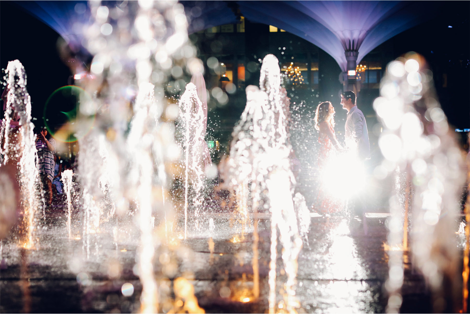 17-Fly-to-Me-Destination-Engagement-Session-Vick-Photography-Fort-Worth-Texas-Couple-Night-Skyline-City-Lights-Downtown-Fountain-Maggie-and-Matt.jpg