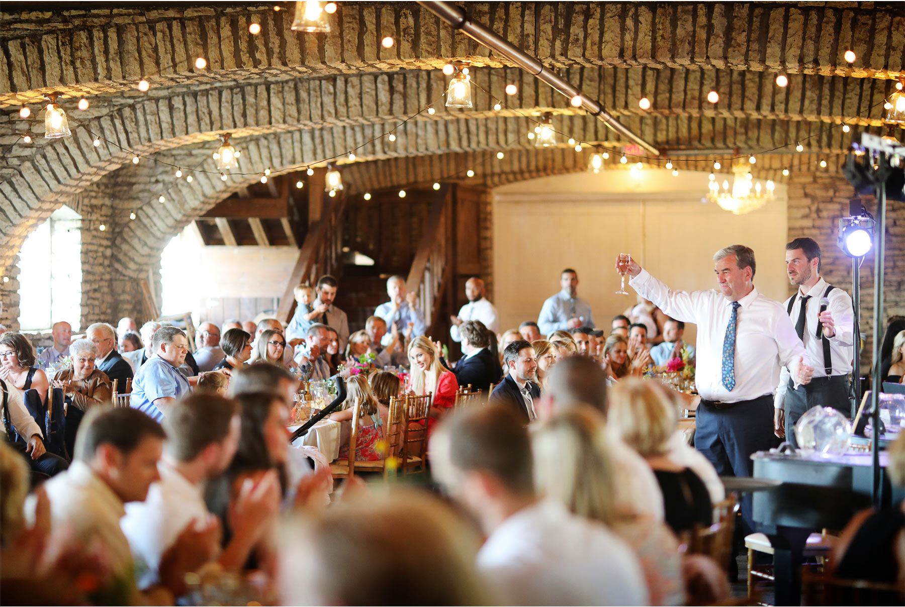 22-Vick-Photography-Rochester-Minnesota-Mayowood-Stone-Barn-Country-Wedding-Reception-Toast-Lizz-and-Brady.jpg