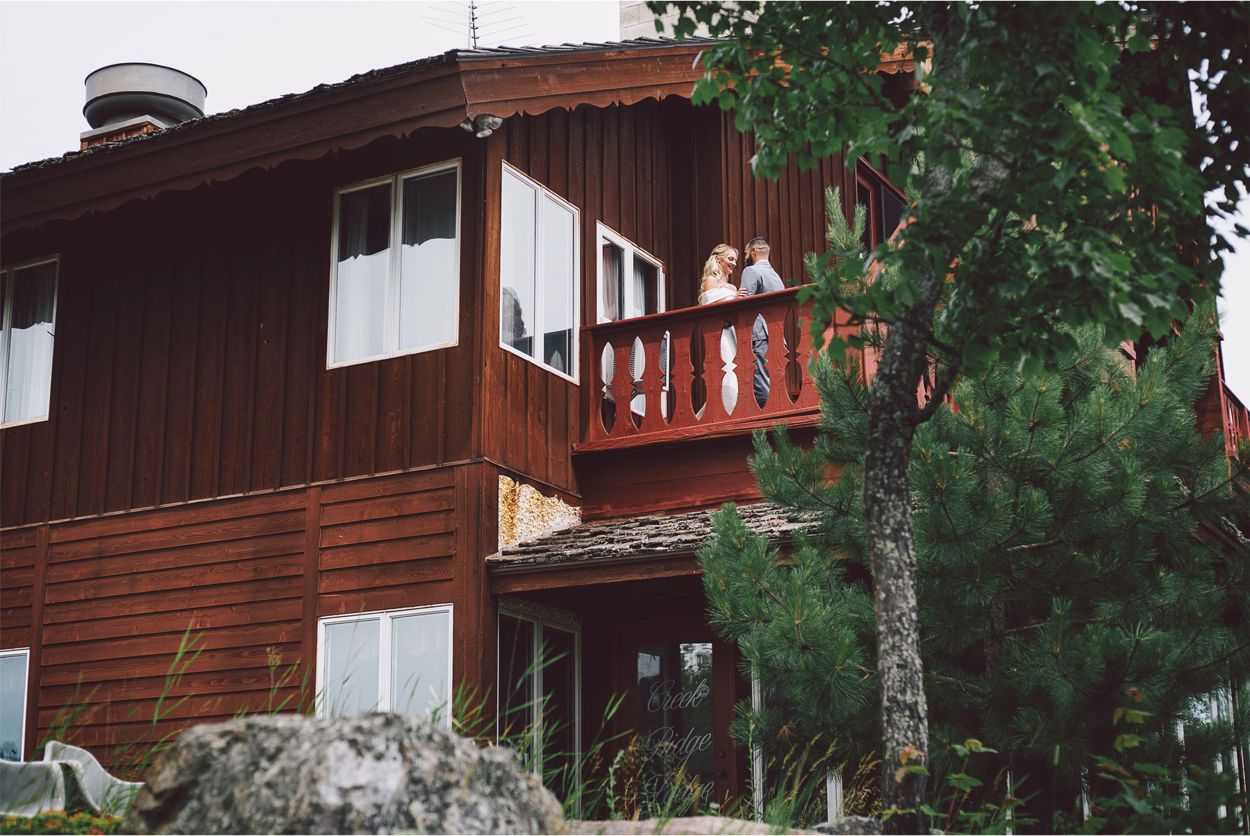 04-Ely-Minnesota-North-Wedding-by-Andrew-Vick-Photography-Bride-Groom-First-Look-Cabin-Woods-Katie-and-Joe.jpg