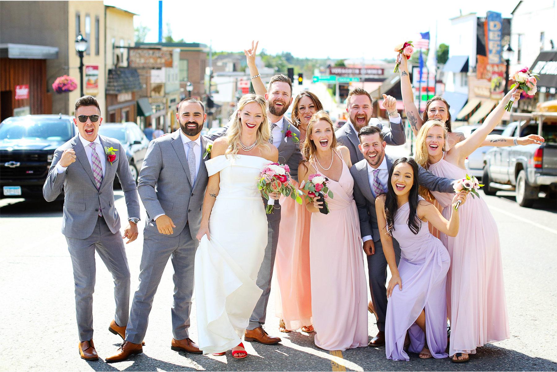 13-Ely-Minnesota-North-Wedding-by-Andrew-Vick-Photography-Bridesmaids-Groomsmen-Street-Katie-and-Joe.jpg