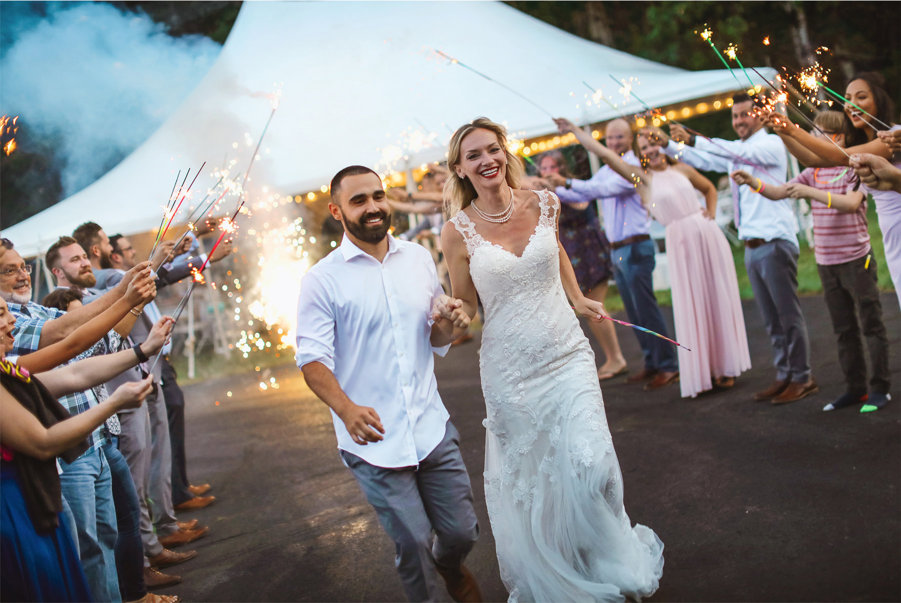 22-Ely-Minnesota-North-Wedding-by-Andrew-Vick-Photography-Sparklers-Send-Off-Bride-Groom-Katie-and-Joe.jpg