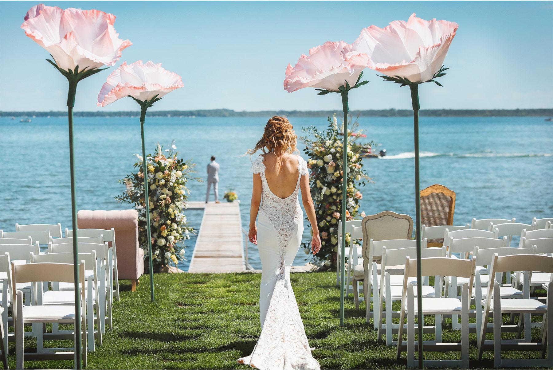 05-Vick-Photography-Wedding-Ottertail-Minnesota-Alice-in-Wonderland-Theme-First-Look-Bride-Groom-Lake-Giant-Poppys-Aisle-Tess-and-Greg.jpg