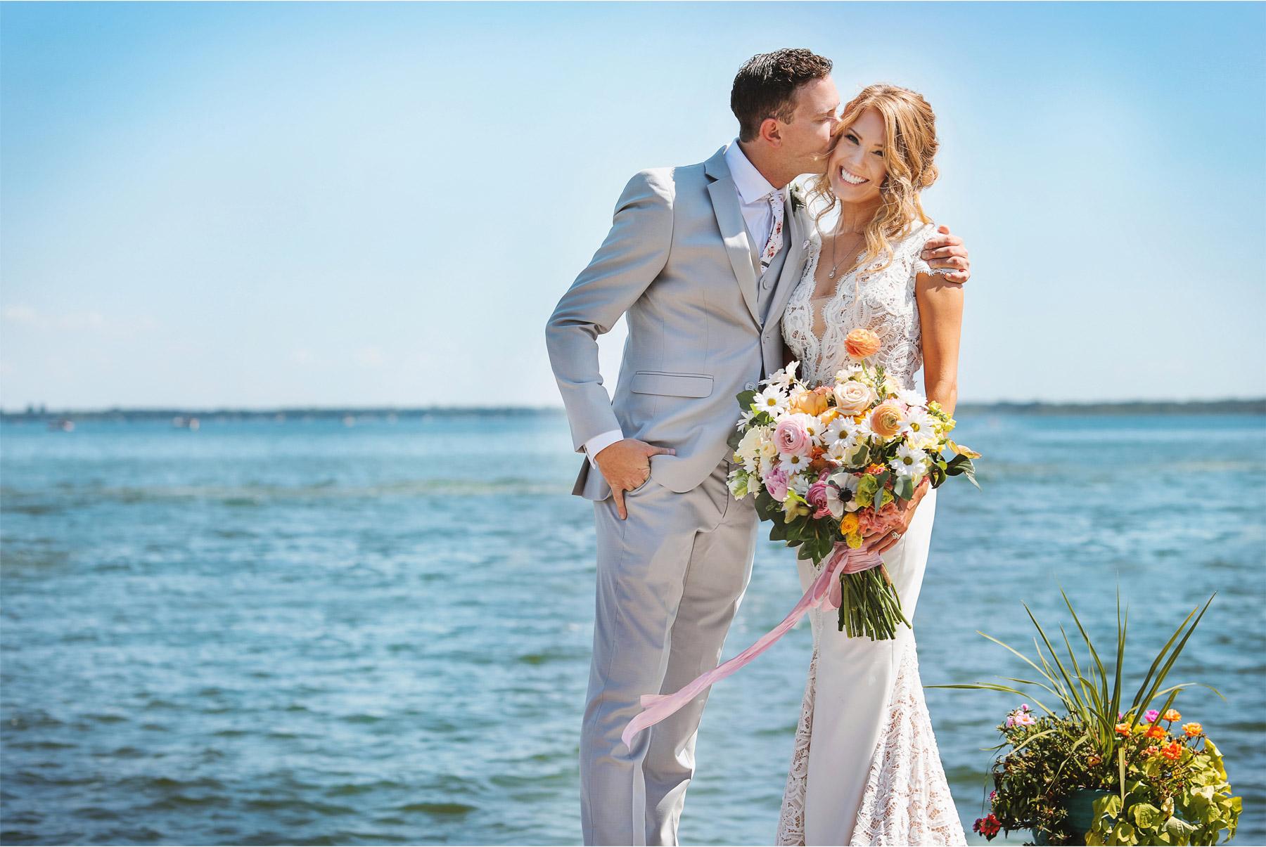 08-Vick-Photography-Wedding-Ottertail-Minnesota-Alice-in-Wonderland-Theme-First-Look-Bride-Groom-Lake-Dock-Tess-and-Greg.jpg