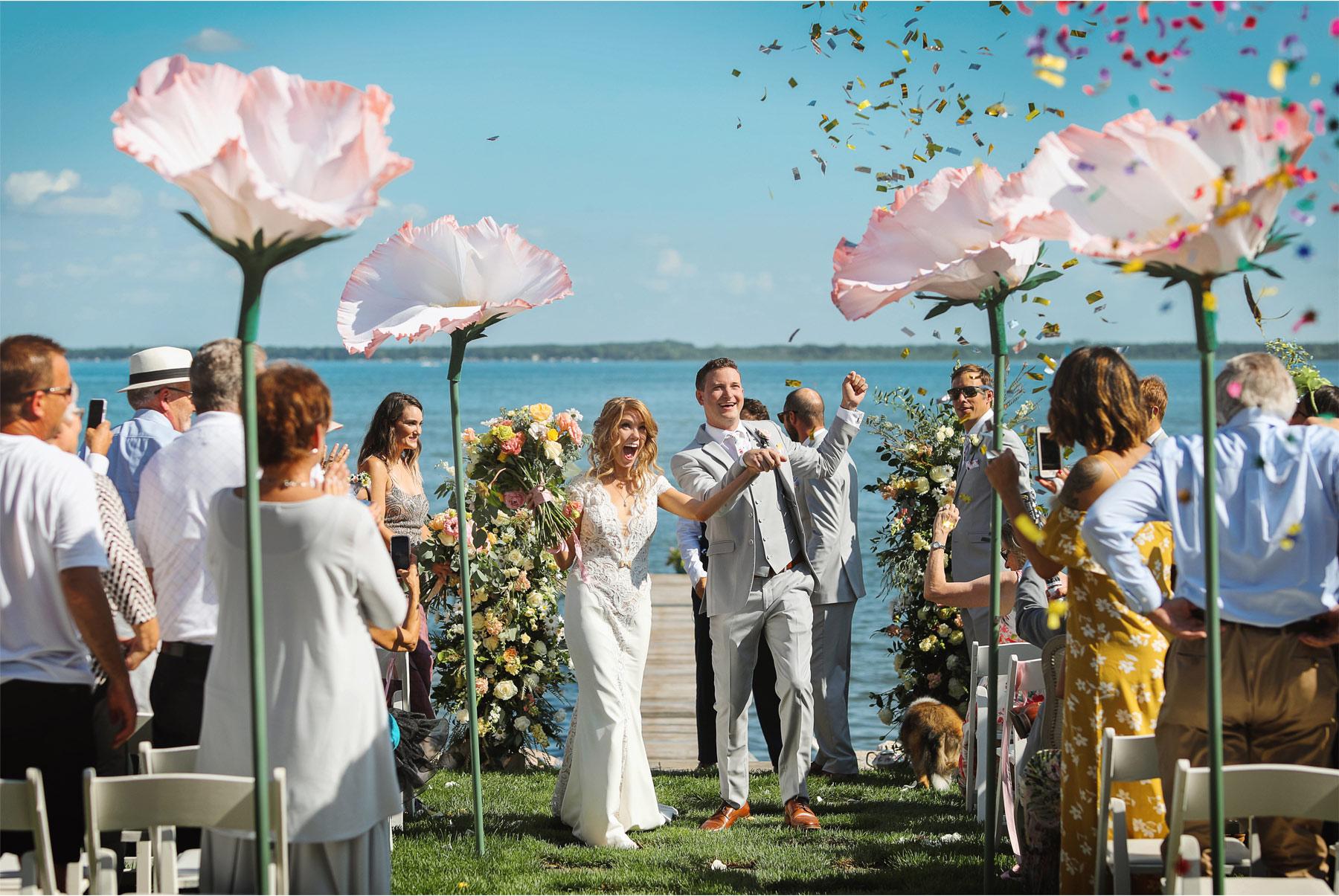 14-Vick-Photography-Wedding-Ottertail-Minnesota-Alice-in-Wonderland-Theme-Ceremony-Outdoor-Lake-Bride-Groom-Giant-Poppys-Flowers-Confetti-Tess-and-Greg.jpg