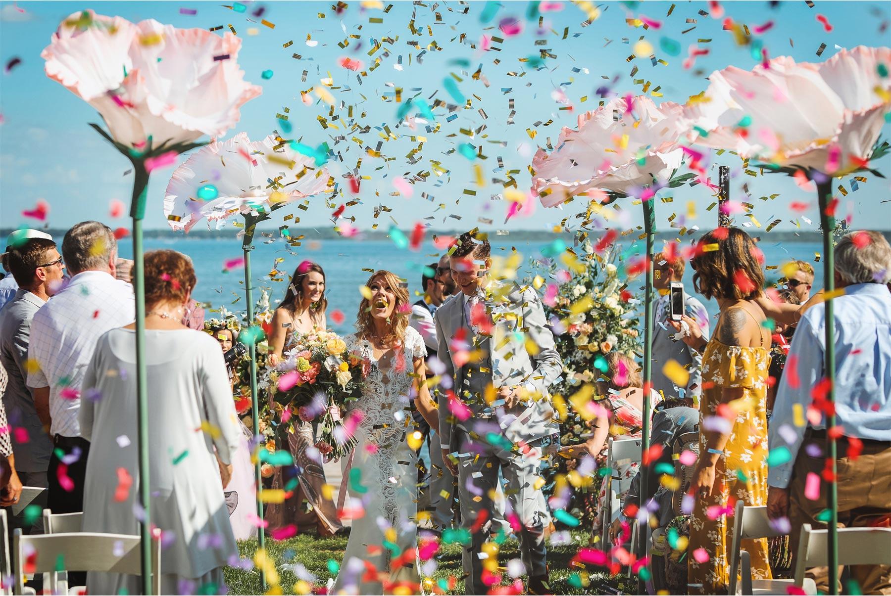15-Vick-Photography-Wedding-Ottertail-Minnesota-Alice-in-Wonderland-Theme-Ceremony-Outdoor-Lake-Bride-Groom-Giant-Poppys-Flowers-Confetti-Tess-and-Greg.jpg