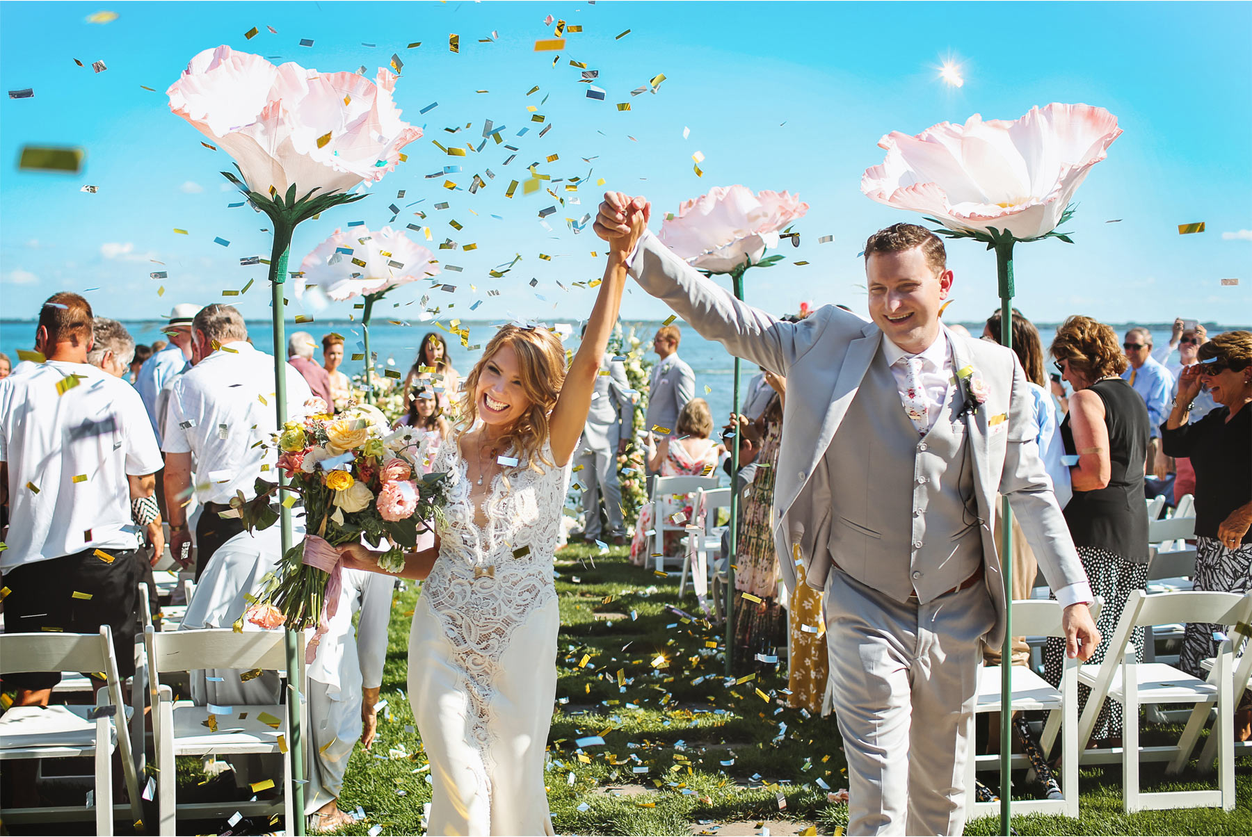 16-Vick-Photography-Wedding-Ottertail-Minnesota-Alice-in-Wonderland-Theme-Ceremony-Outdoor-Lake-Bride-Groom-Giant-Poppys-Flowers-Confetti-Tess-and-Greg.jpg