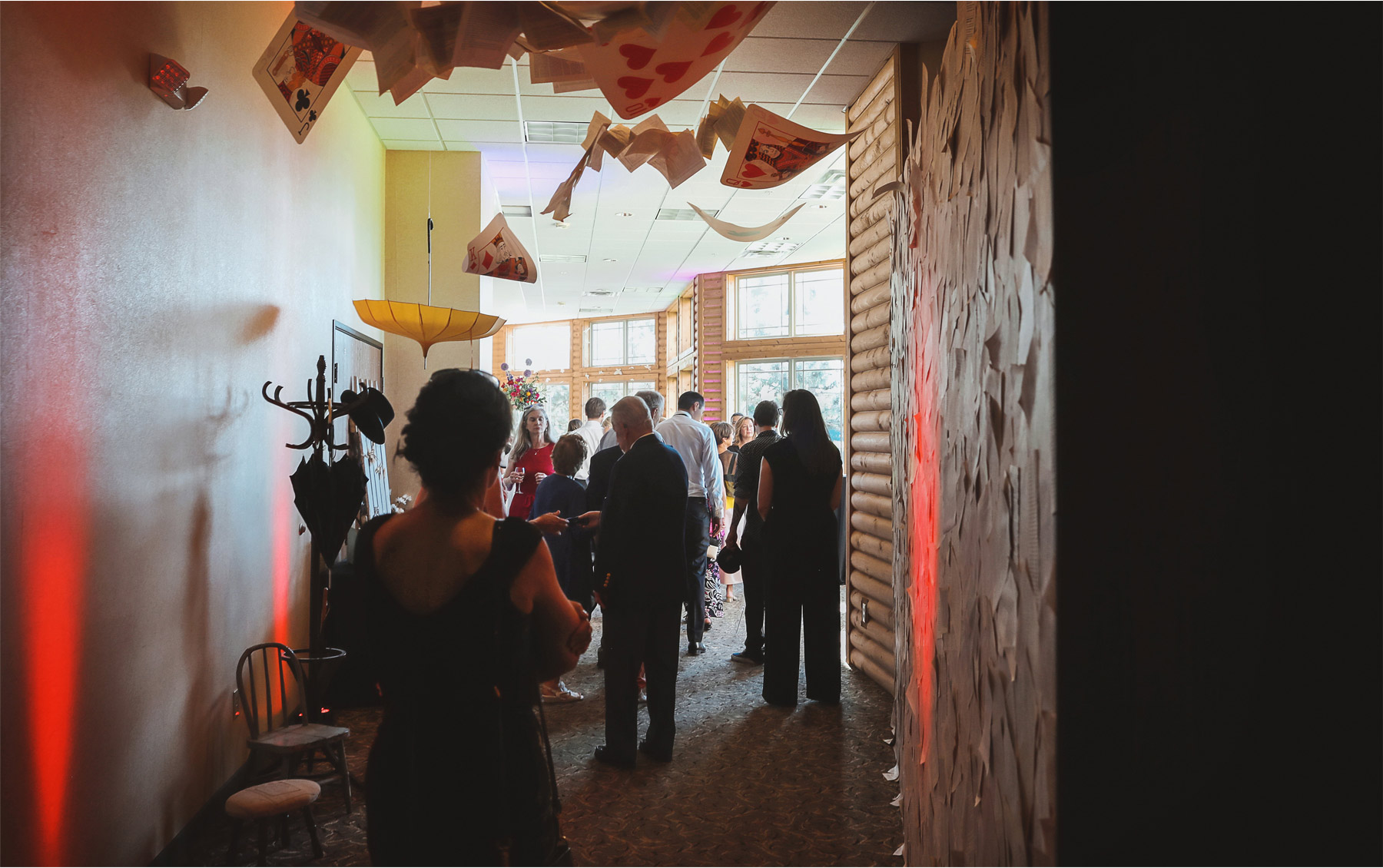 20-Vick-Photography-Wedding-Ottertail-Minnesota-Alice-in-Wonderland-Theme-Reception-Book-Pages-Playing-Cards-Tess-and-Greg.jpg