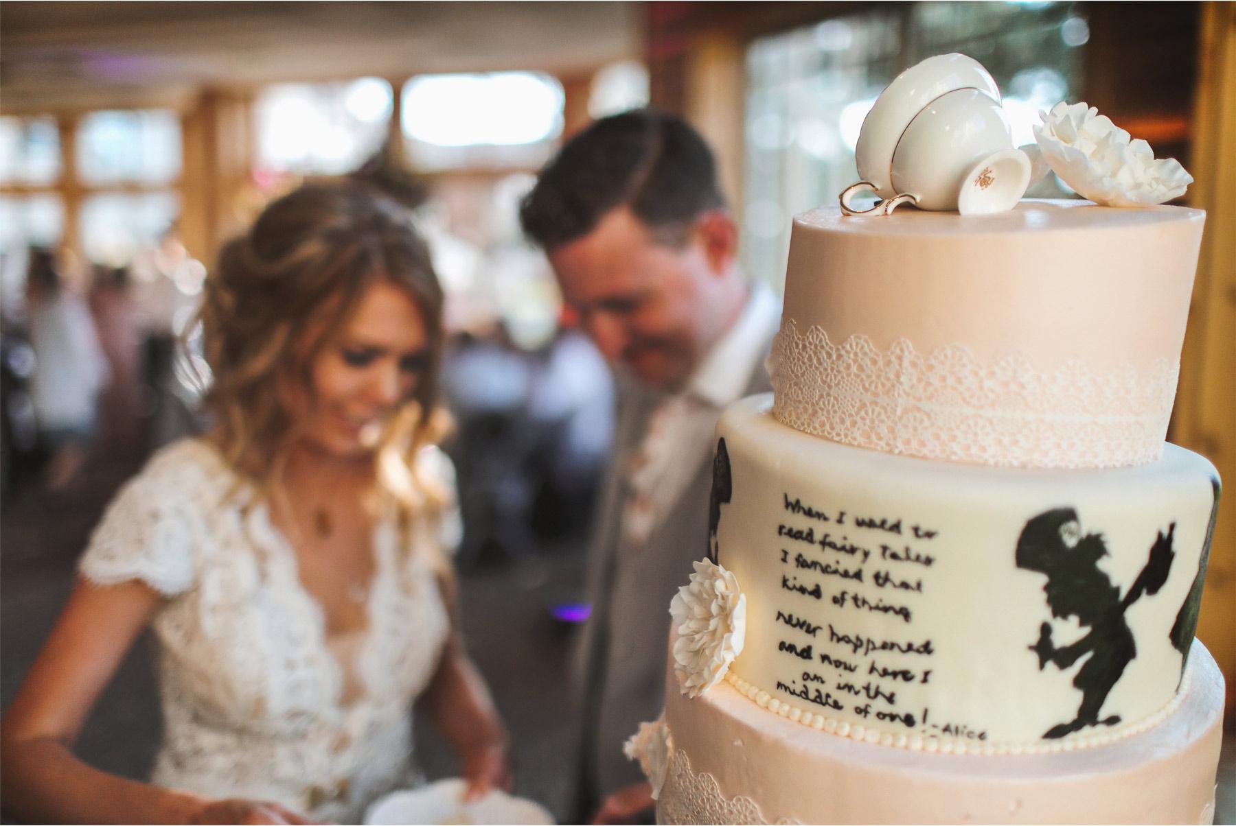 22-Vick-Photography-Wedding-Ottertail-Minnesota-Alice-in-Wonderland-Theme-Reception-Cake-Cutting-Bride-Groom-Rabit-Tess-and-Greg.jpg