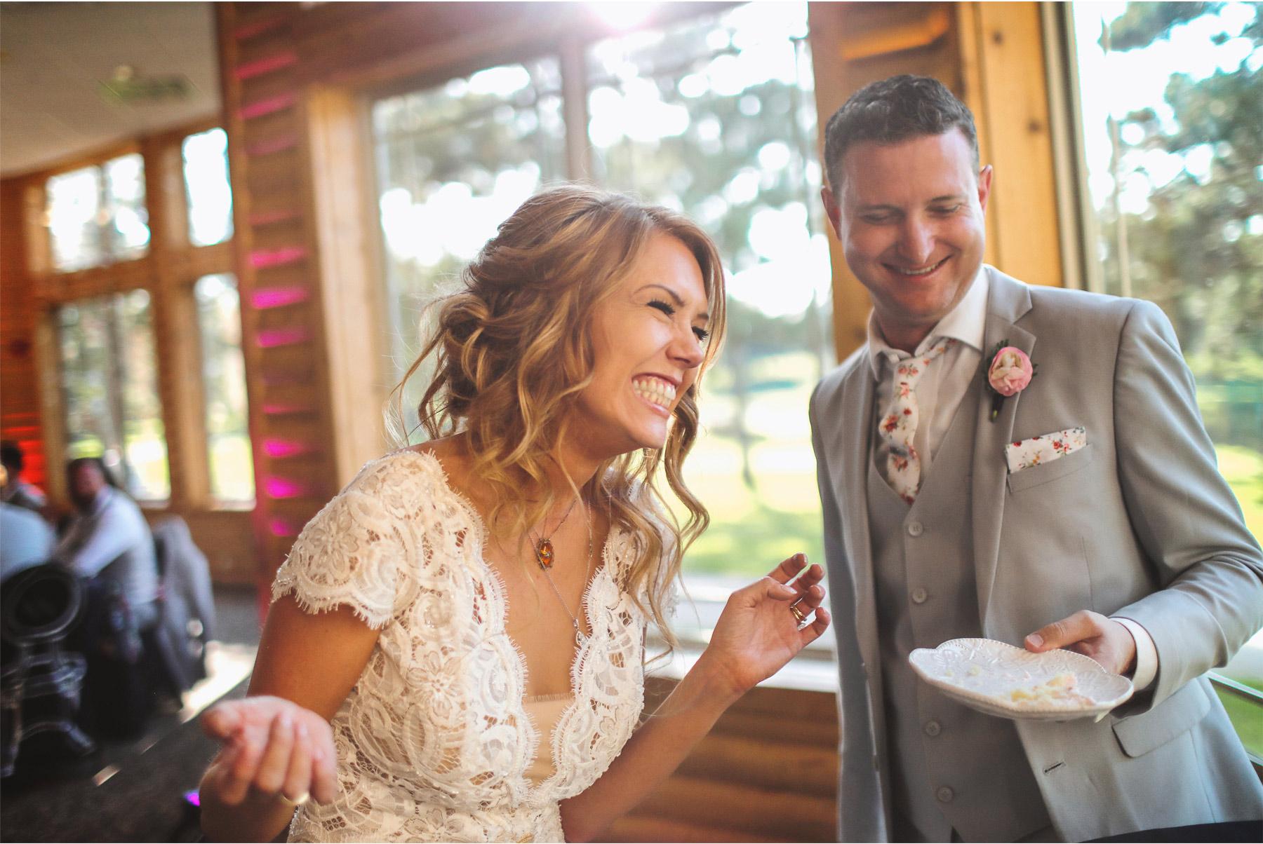 23-Vick-Photography-Wedding-Ottertail-Minnesota-Alice-in-Wonderland-Theme-Reception-Cake-Cutting-Bride-Groom-Rabit-Tess-and-Greg.jpg