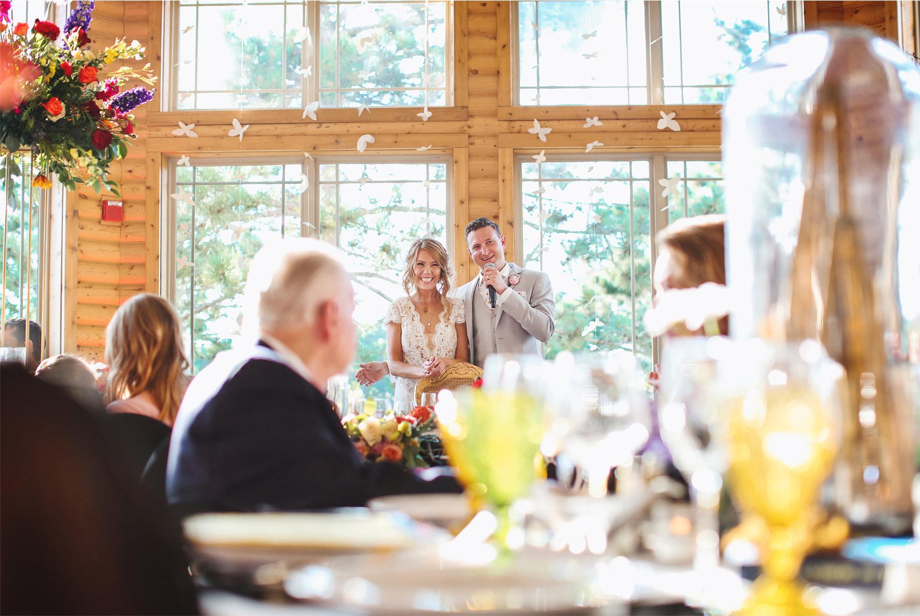 24-Vick-Photography-Wedding-Ottertail-Minnesota-Alice-in-Wonderland-Theme-Reception-Bride-Groom-Toast-Tess-and-Greg.jpg