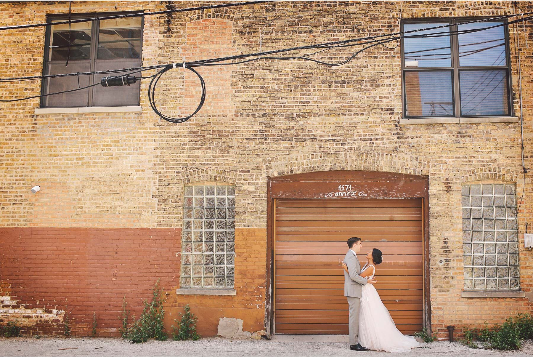 03-Wedding-by-Andrew-Vick-Photography-Chicago-Illinois-Bride-Groom-First-Look-Downtown-Brownstone-Ashley-and-Nicholas.jpg