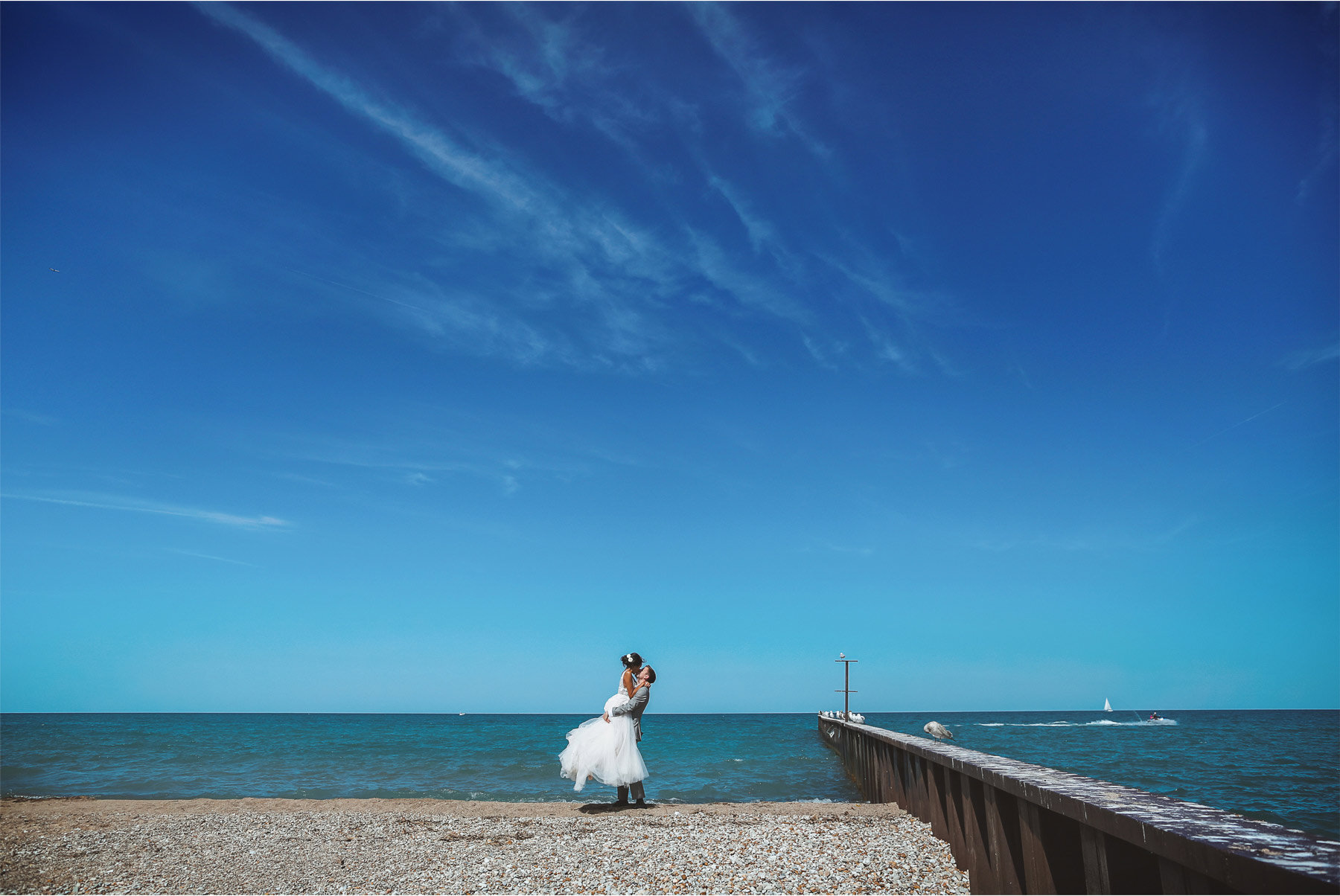 12-Wedding-by-Andrew-Vick-Photography-Chicago-Illinois-Groom-Bride-Shore-Beach-Lake-Michigan-Ashley-and-Nicholas.jpg