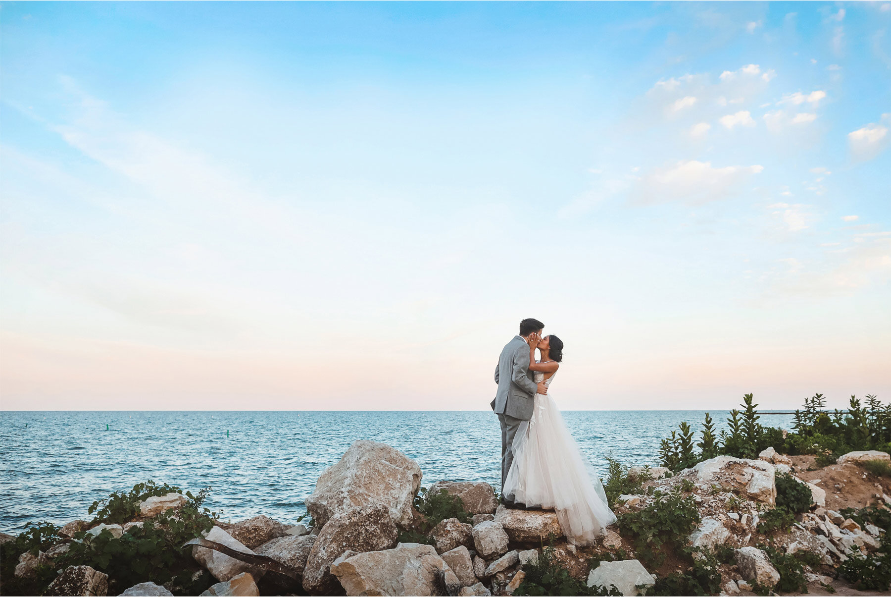19-Wedding-by-Andrew-Vick-Photography-Chicago-Illinois-Groom-Bride-Shore-Beach-Lake-Michigan-Ashley-and-Nicholas.jpg