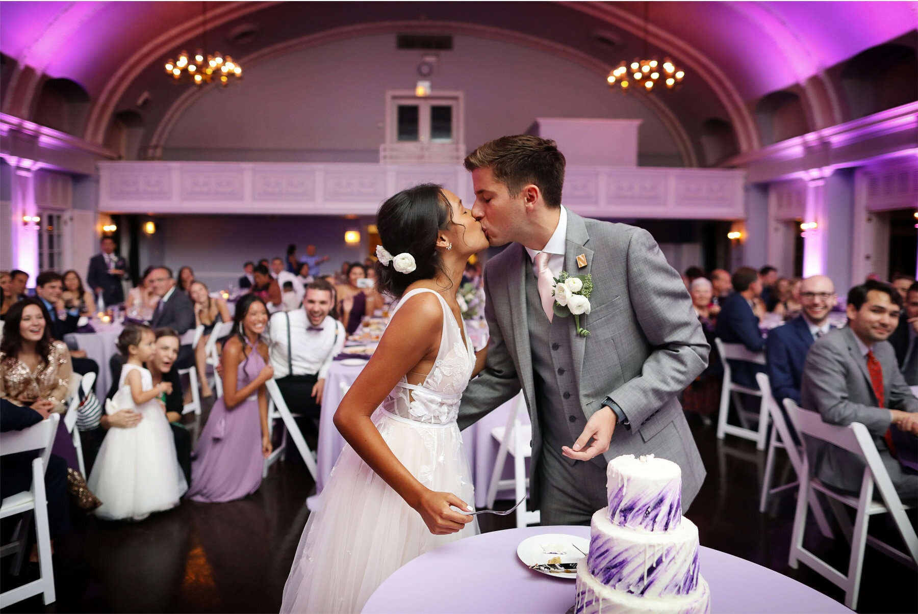 24-Wedding-by-Andrew-Vick-Photography-Chicago-Illinois-Reception-Womans-Club-of-Evanston-Cake-Kiss-Ashley-and-Nicholas.jpg