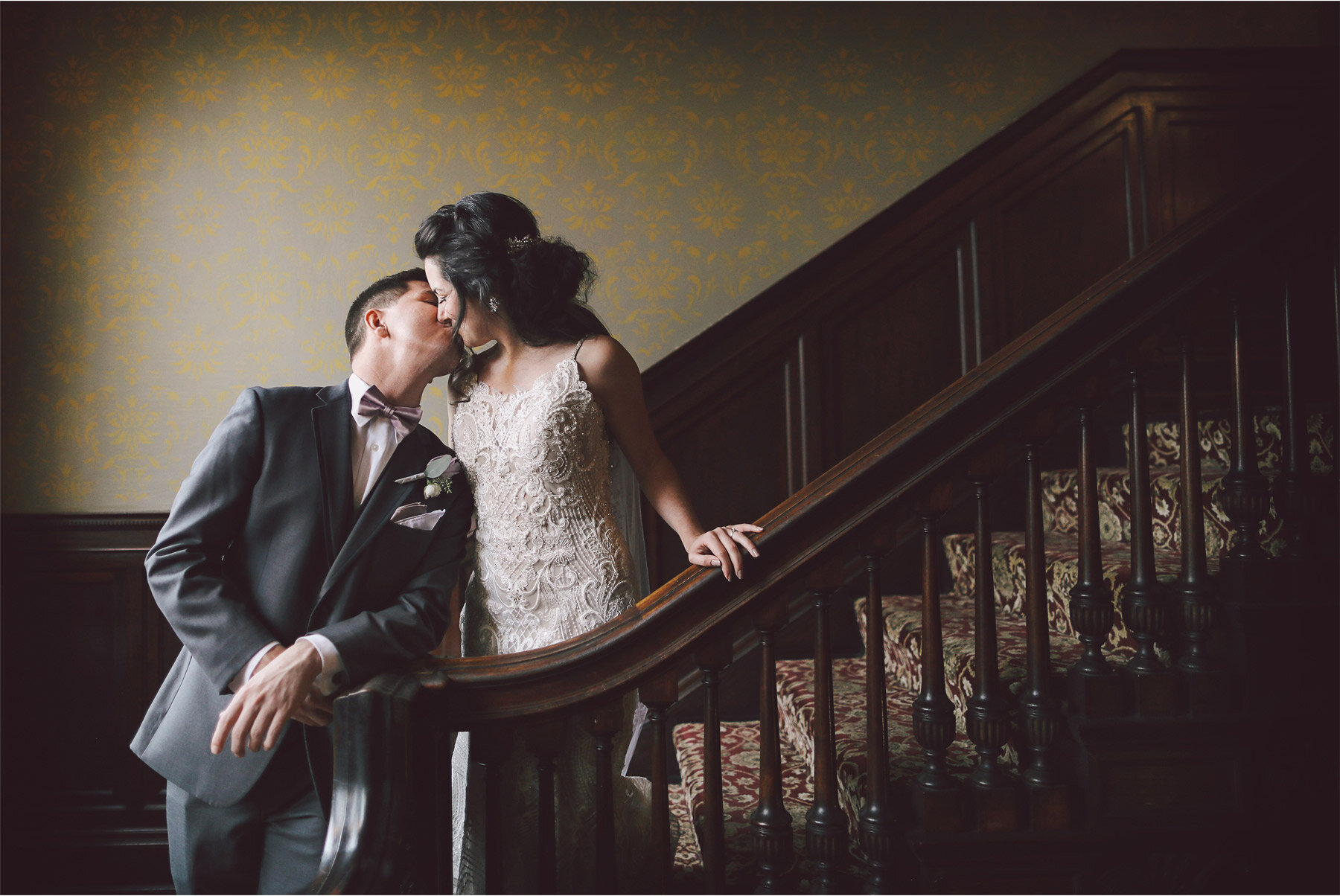 05-Wedding-by-Vick-Photography-Minneapolis-Minnesota-Semple-Mansion-Historic-Venue-Bride-Groom-First-Look-Staircase-Kiss-Kaitlyn-and-Nate.jpg