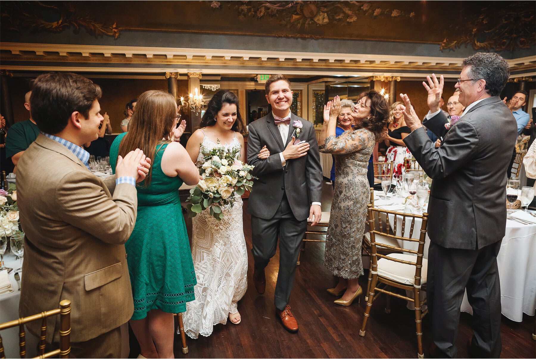 11-Wedding-by-Vick-Photography-Minneapolis-Minnesota-Semple-Mansion-Historic-Venue-Reception-Bride-Groom-Cheering-Kaitlyn-and-Nate.jpg