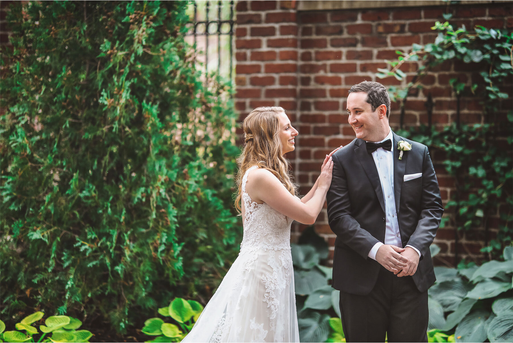 03-Minnesota-Wedding-Vick-Photography-Minneapolis-Event-Centers-Bride-Groom-First-Look-Courtyard-Amy-and-Avi.jpg