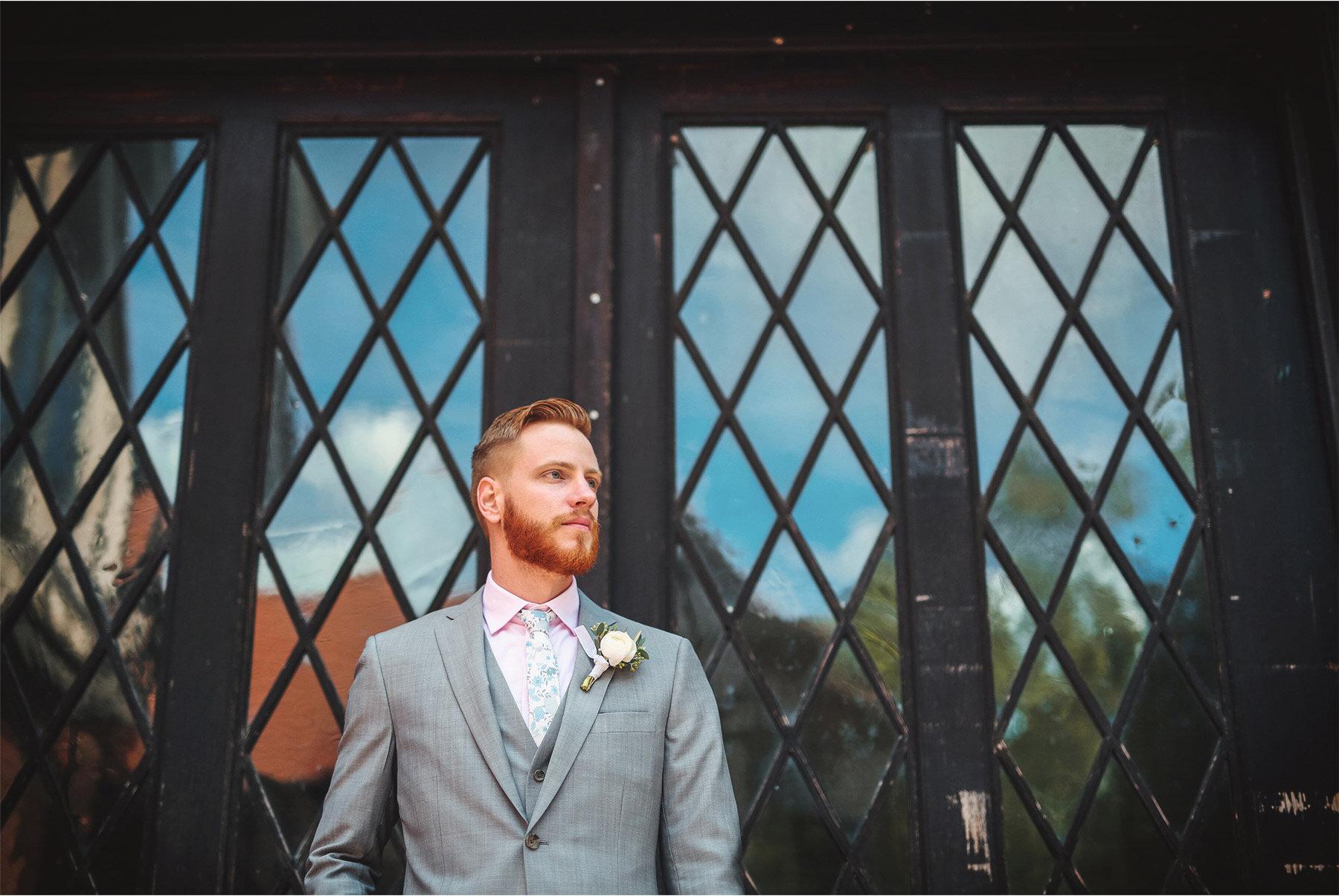 04-Vick-Photography-Wedding-Duluth-Minnesota-Glensheen-Mansion-Groom-Doors-Blue-Sky-Catherine-and-John.jpg