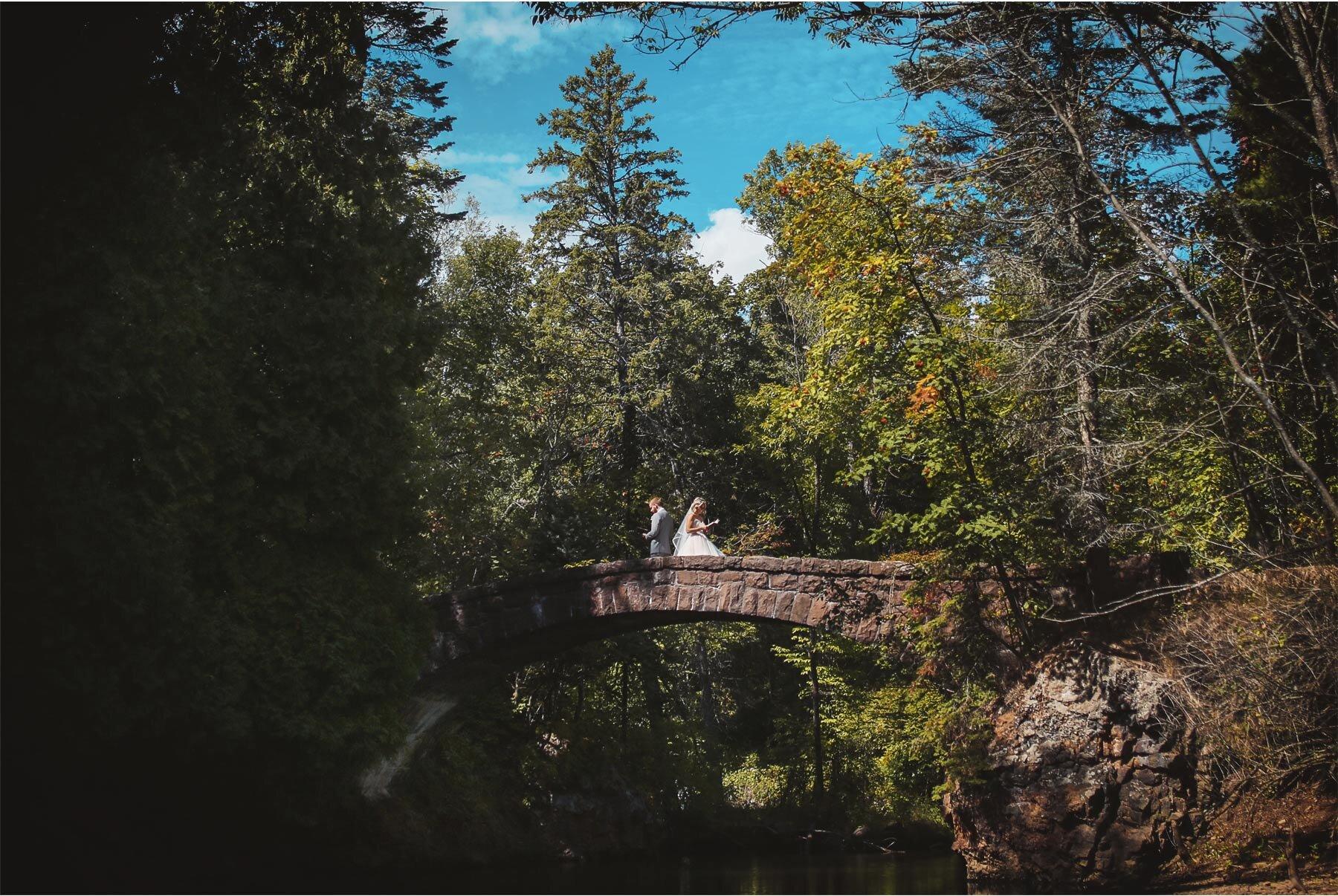 05-Vick-Photography-Wedding-Duluth-Minnesota-Glensheen-Mansion-Groom-Bride-Bridge-Blue-Sky-Catherine-and-John.jpg