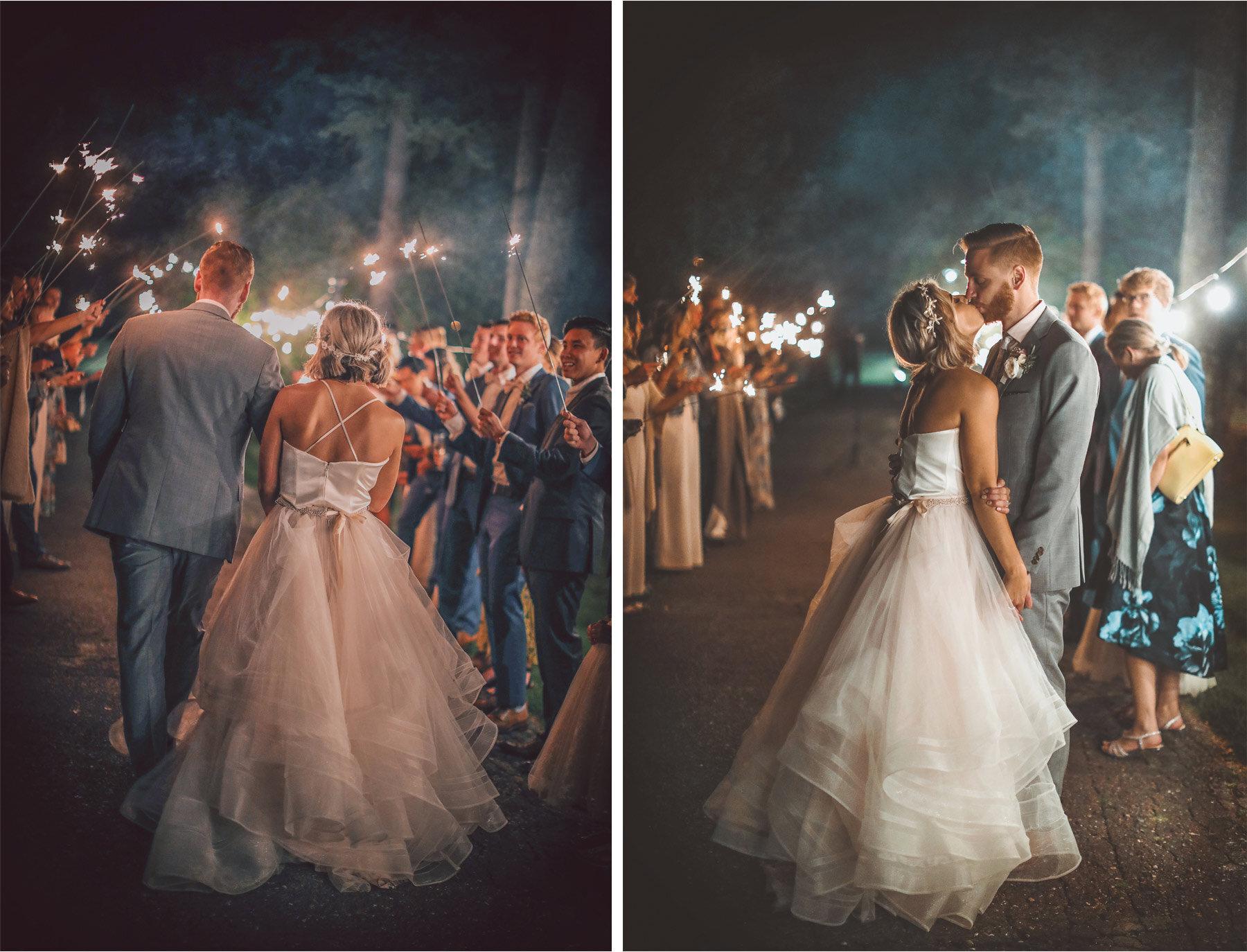 22-Vick-Photography-Wedding-Duluth-Minnesota-Glensheen-Mansion-Sparkler-Send-Off-Kiss-Catherine-and-John.jpg.jpg