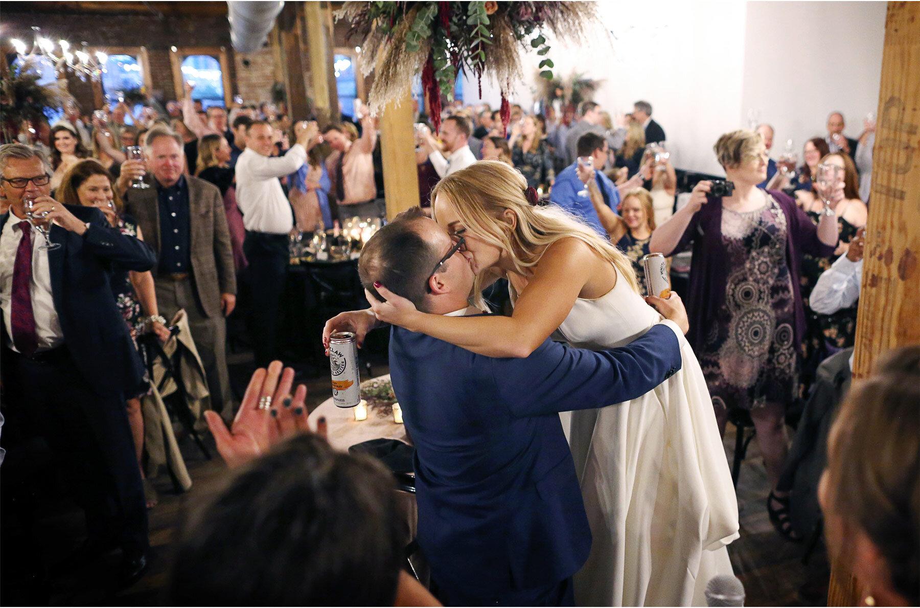 15-Vick-Photography-Wedding-Minneapolis-Minnesota-Earl-and-Wilson-Bride-Groom-Reception-Toast-Kiss-Danielle-and-Tom.jpg