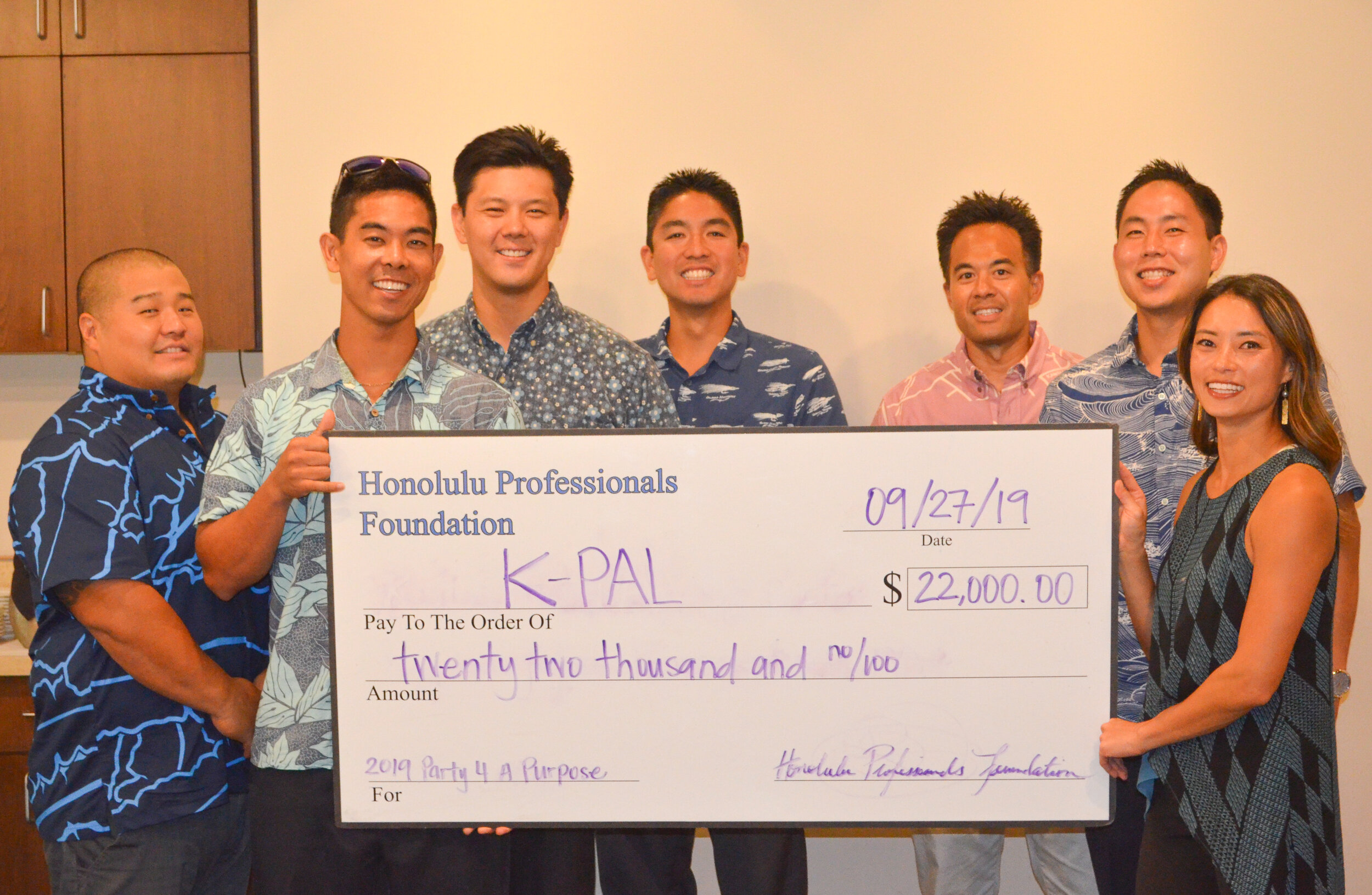 HPF pictured with Sgt. Lance Okasaki from the Kaua'i Police Activities League (K-PAL).