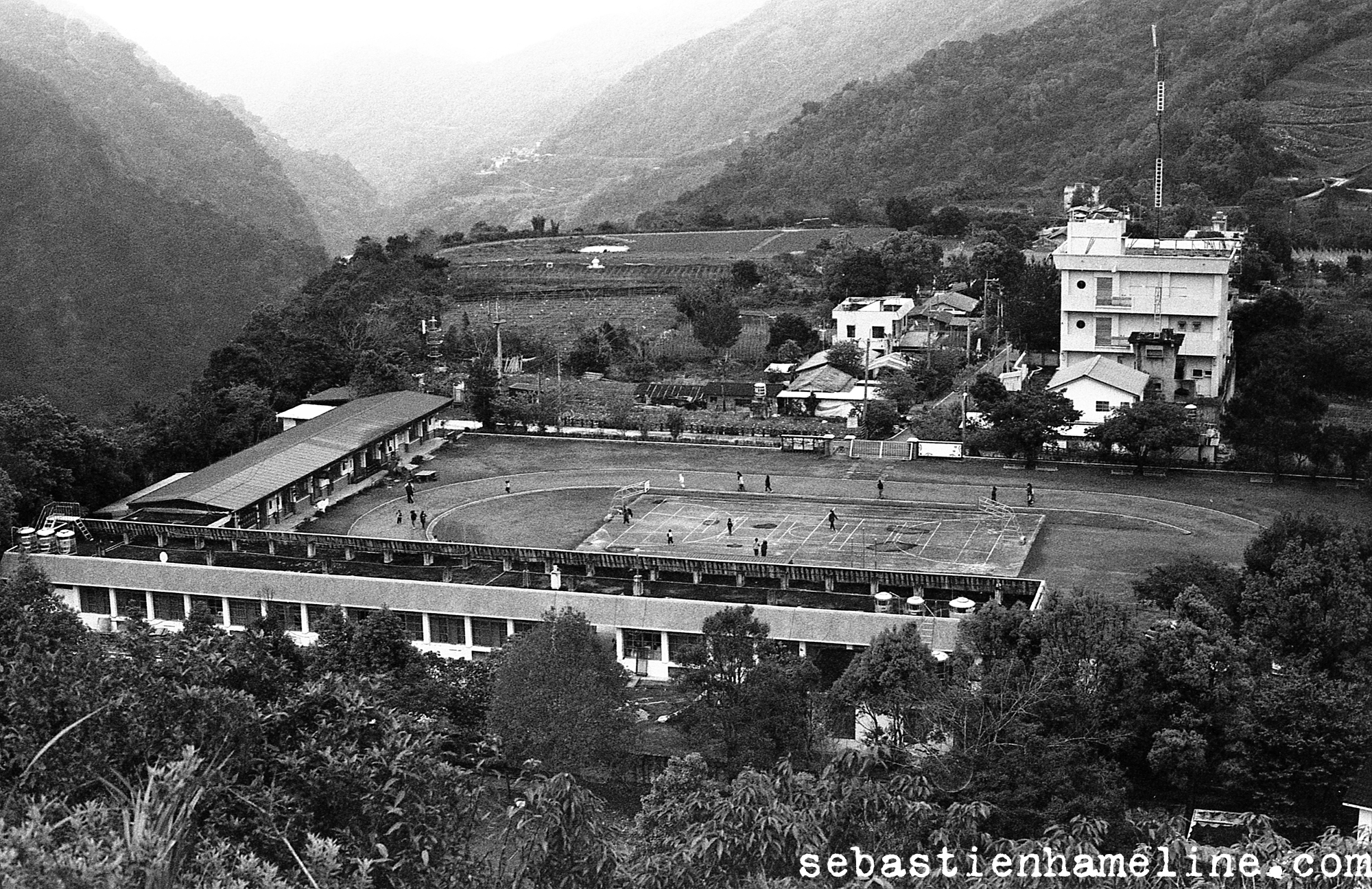 The L shaped building is the elementary school of Wulu village, the one residential street in the back.