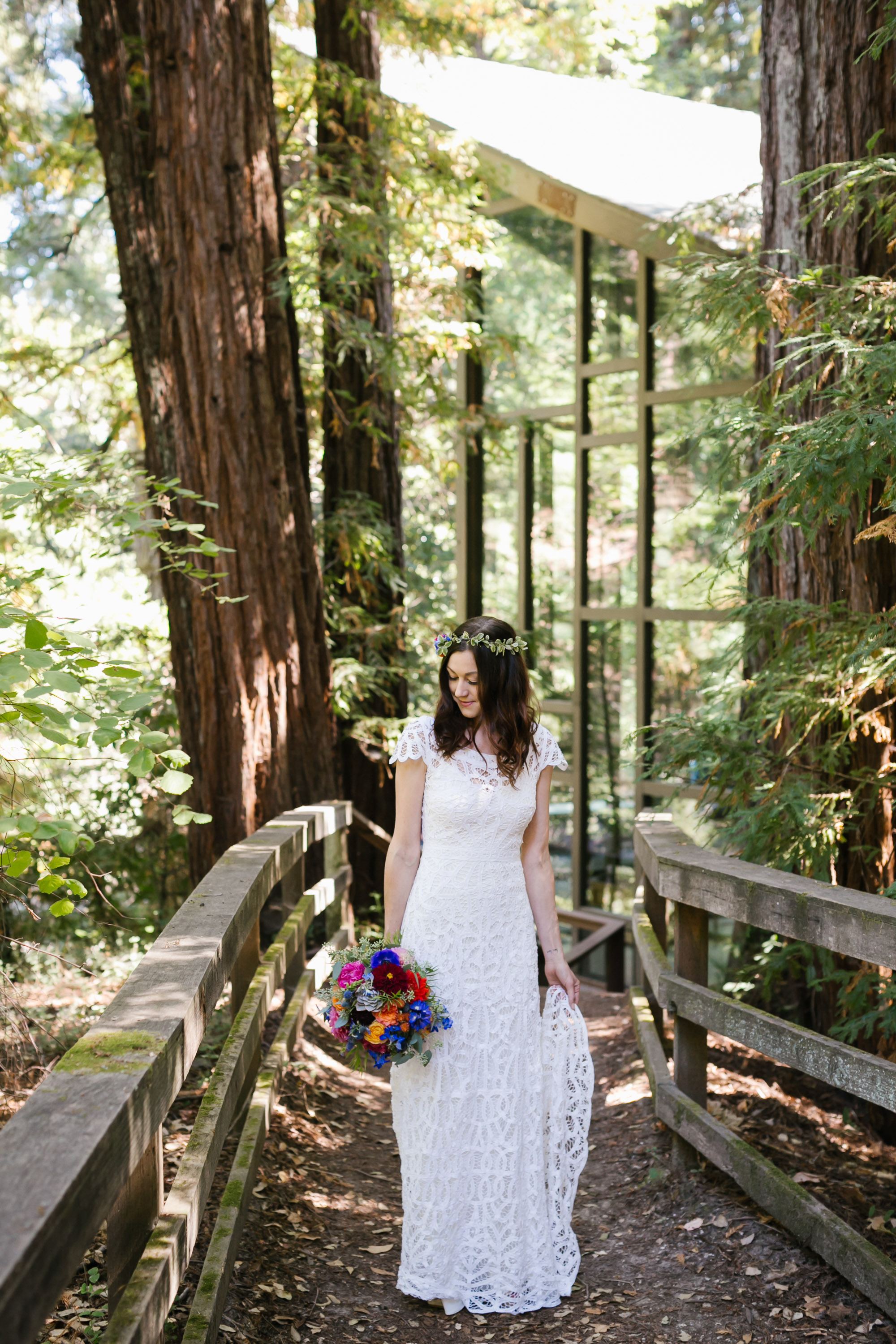 Bride holding colorful bouquet in the forest