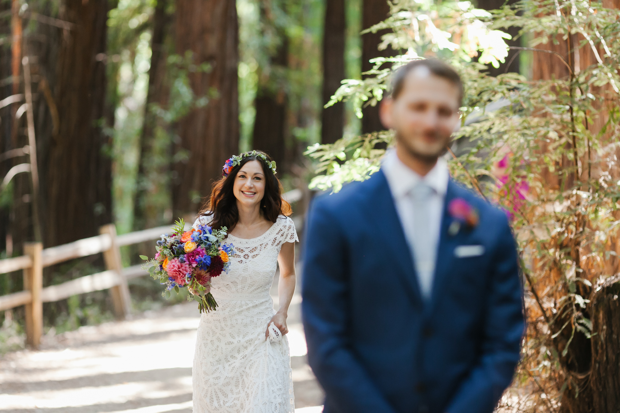 Bride with colorful bouquet walks up to her soon to be husband for their first look