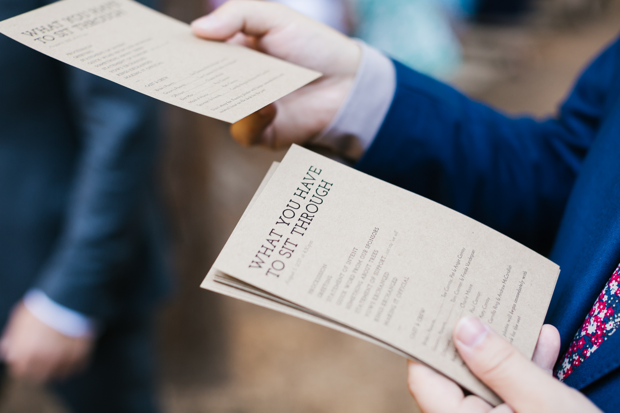Funny wedding programs being handed out