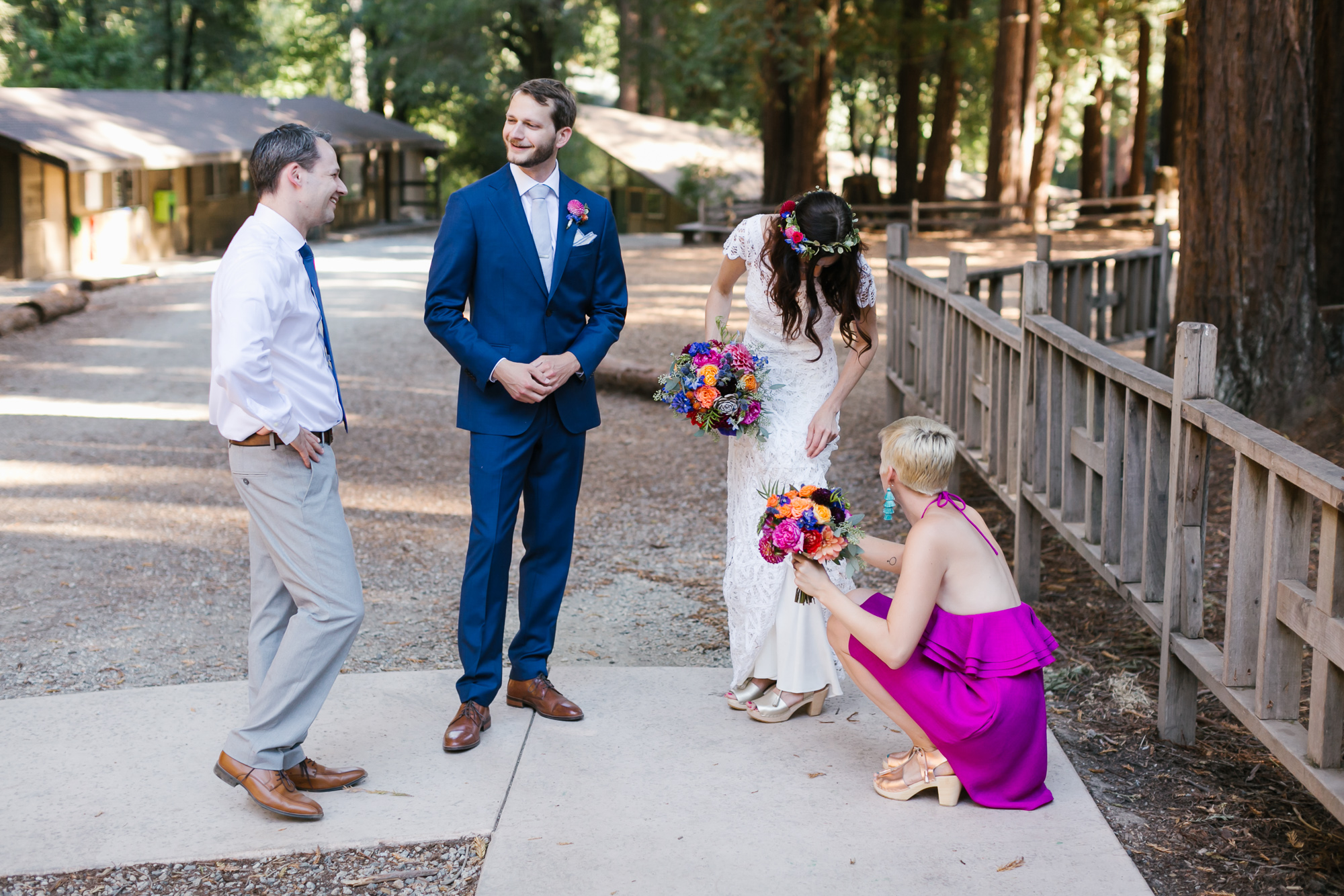 Colorful wedding couple relax with close friends after ceremony