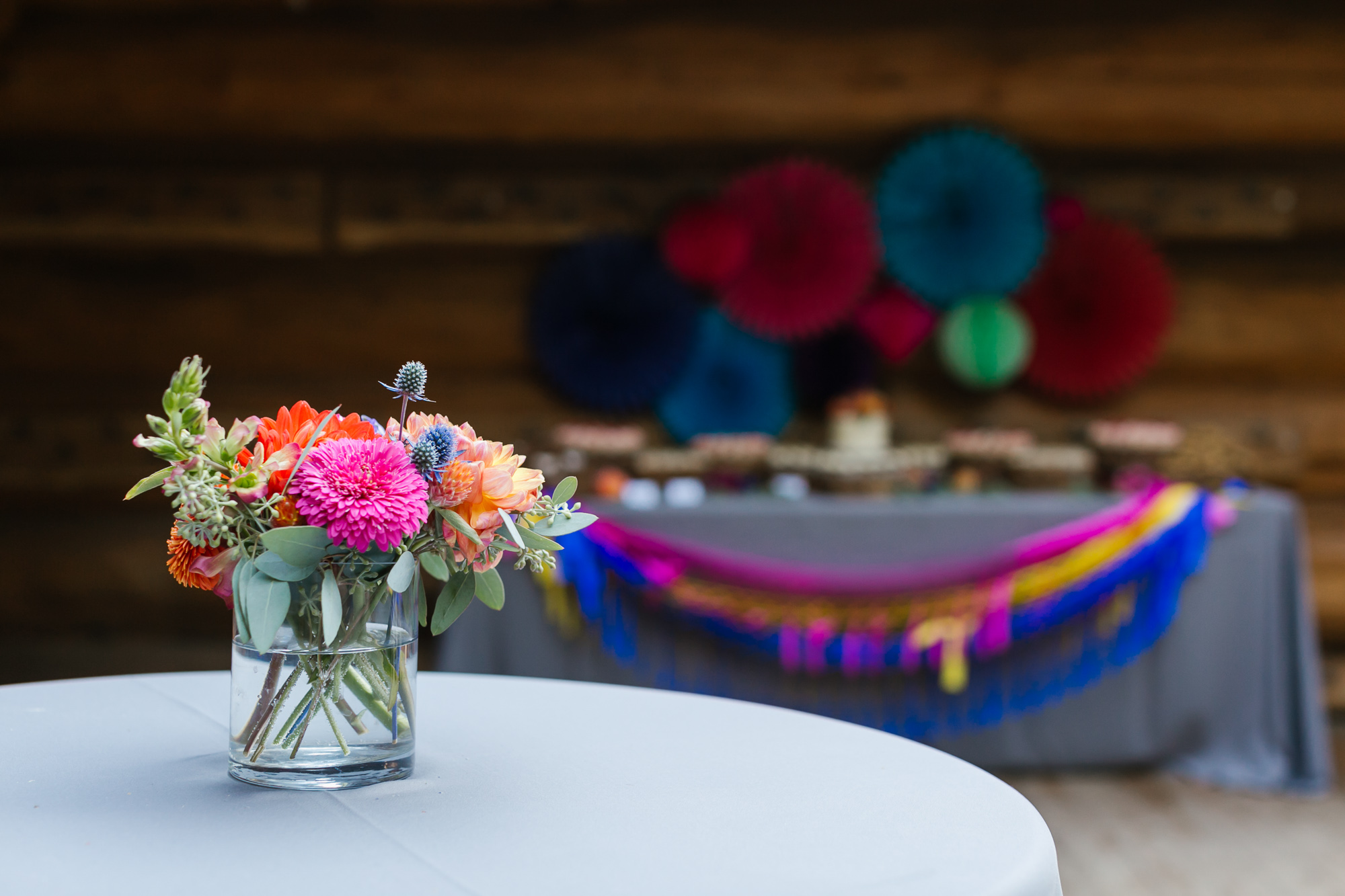 Colorful flowers decorate a cocktail table