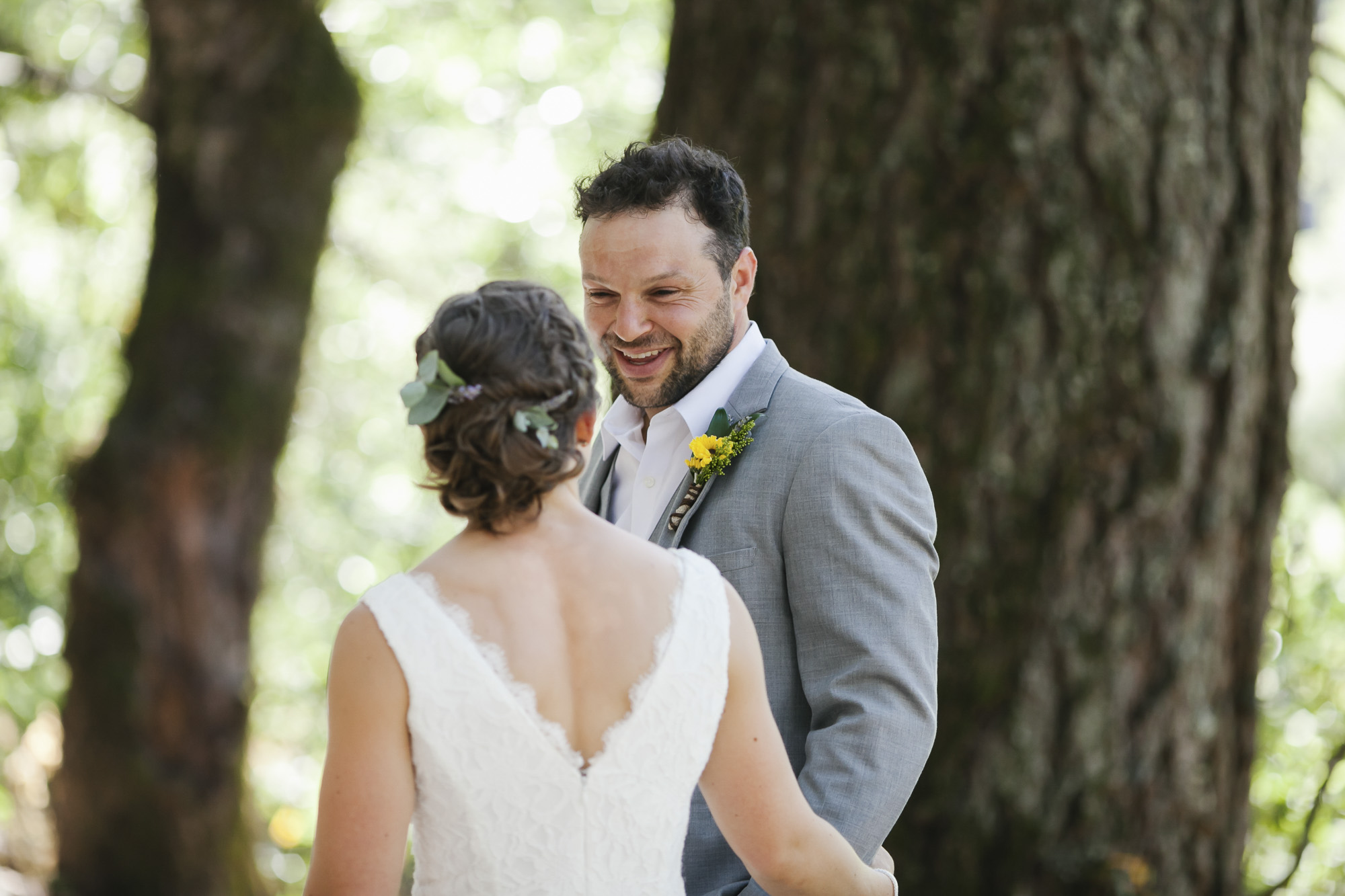 A groom sees his bride for the first time and is excited and happy