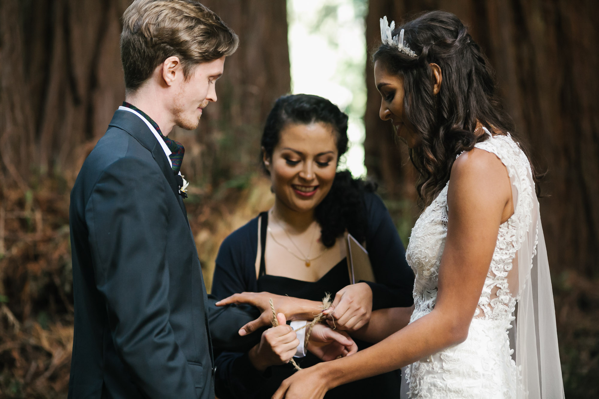 Wedding couple bind hands with rope during ceremony