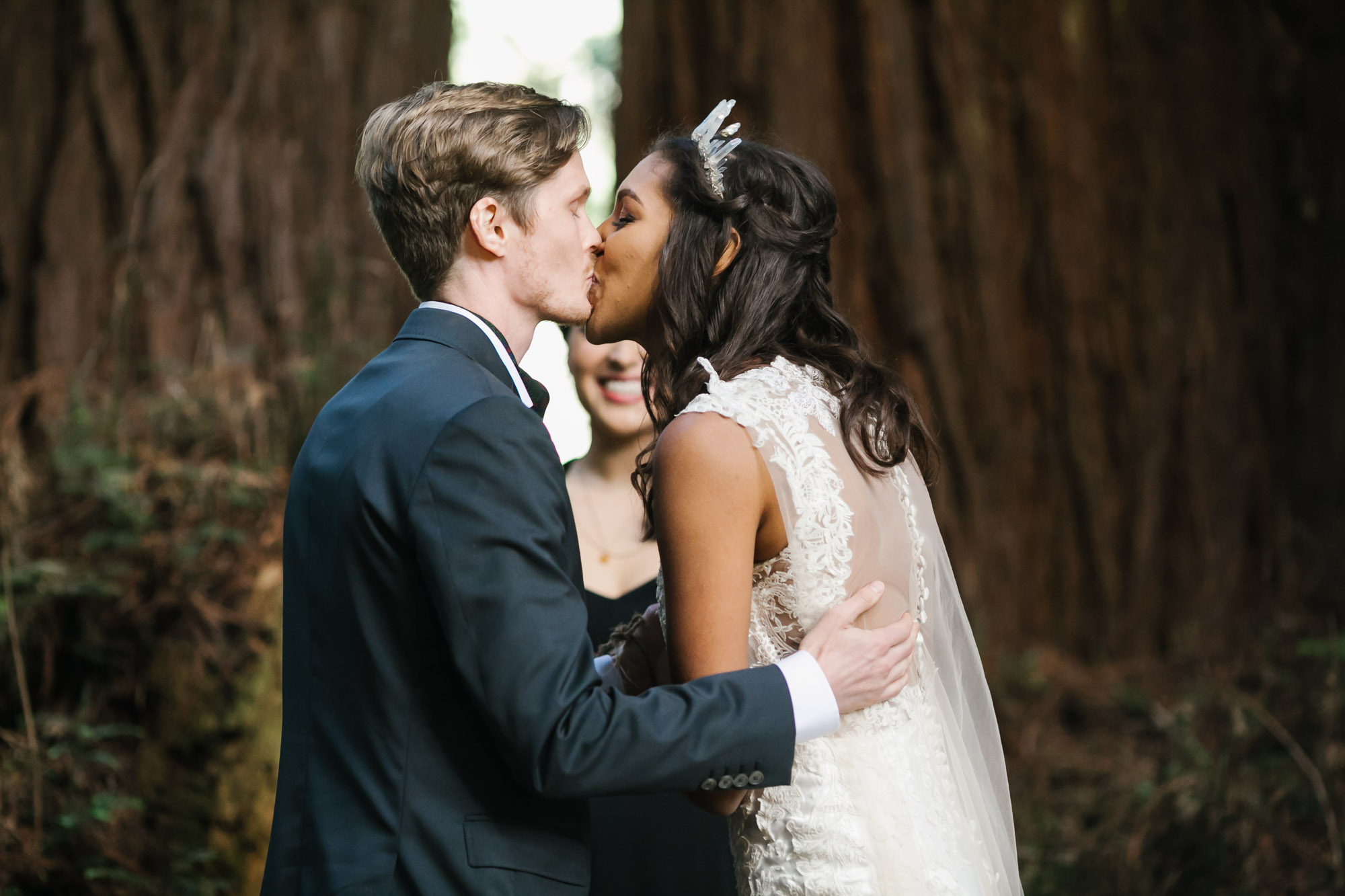 Bride and groom share their first kiss at their wedding ceremony