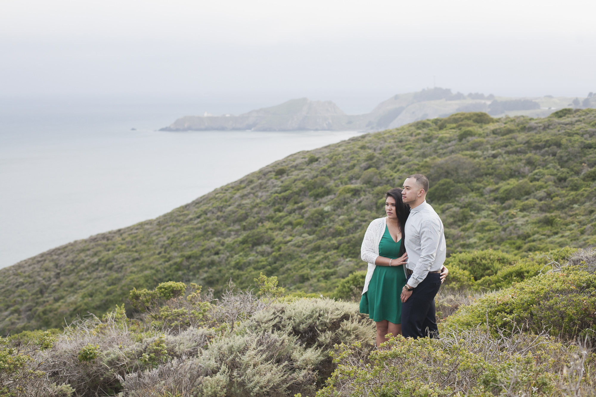 Couple enjoy the view in the green Marin Headlands