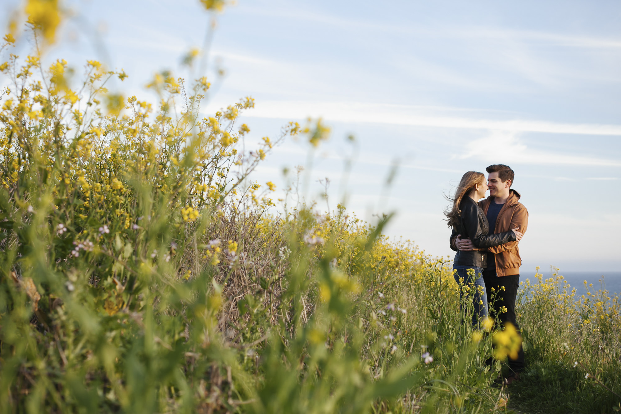 Engagement portrait at Slide Ranch with yellow wildflowers