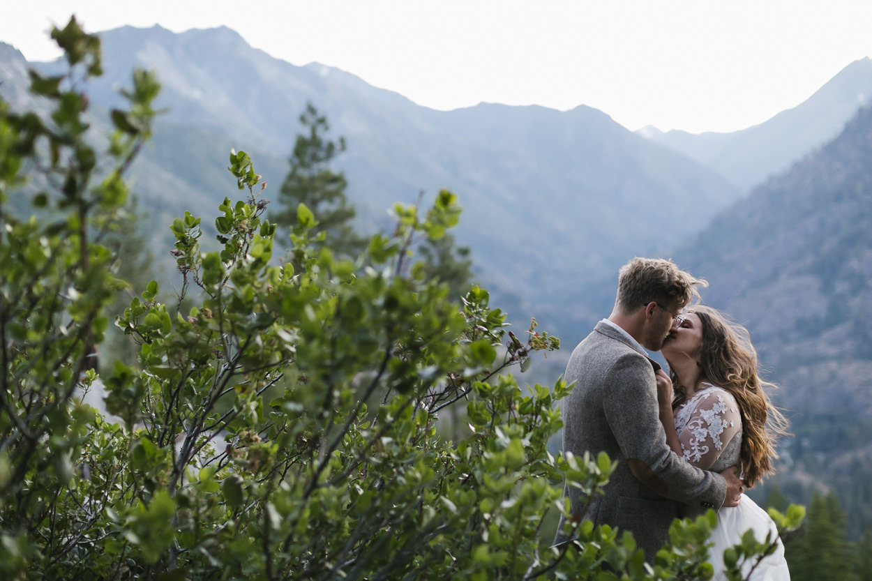 Eloping couple kiss in the Cascade Mountains of Washington