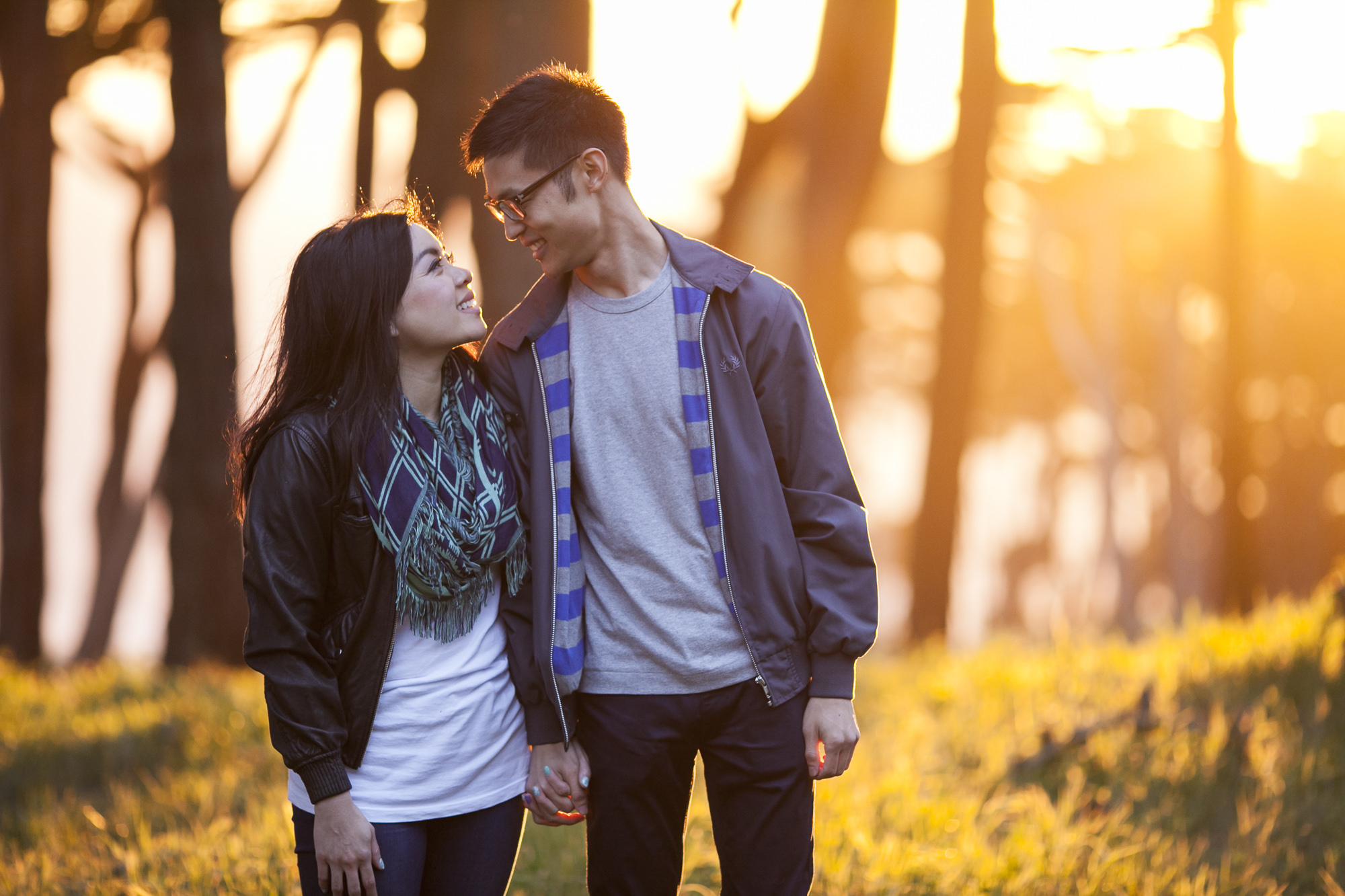 Engagement session at Lands End in San Francisco with golden sunset behind